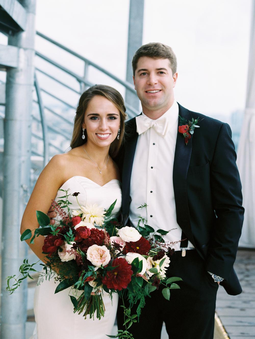 Rooftop bride and groom portraits // Nashville Wedding Floral Design