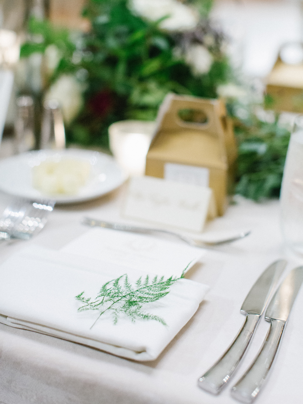 Airy sprigs of greenery for each place setting // Nashville Wedding Florist