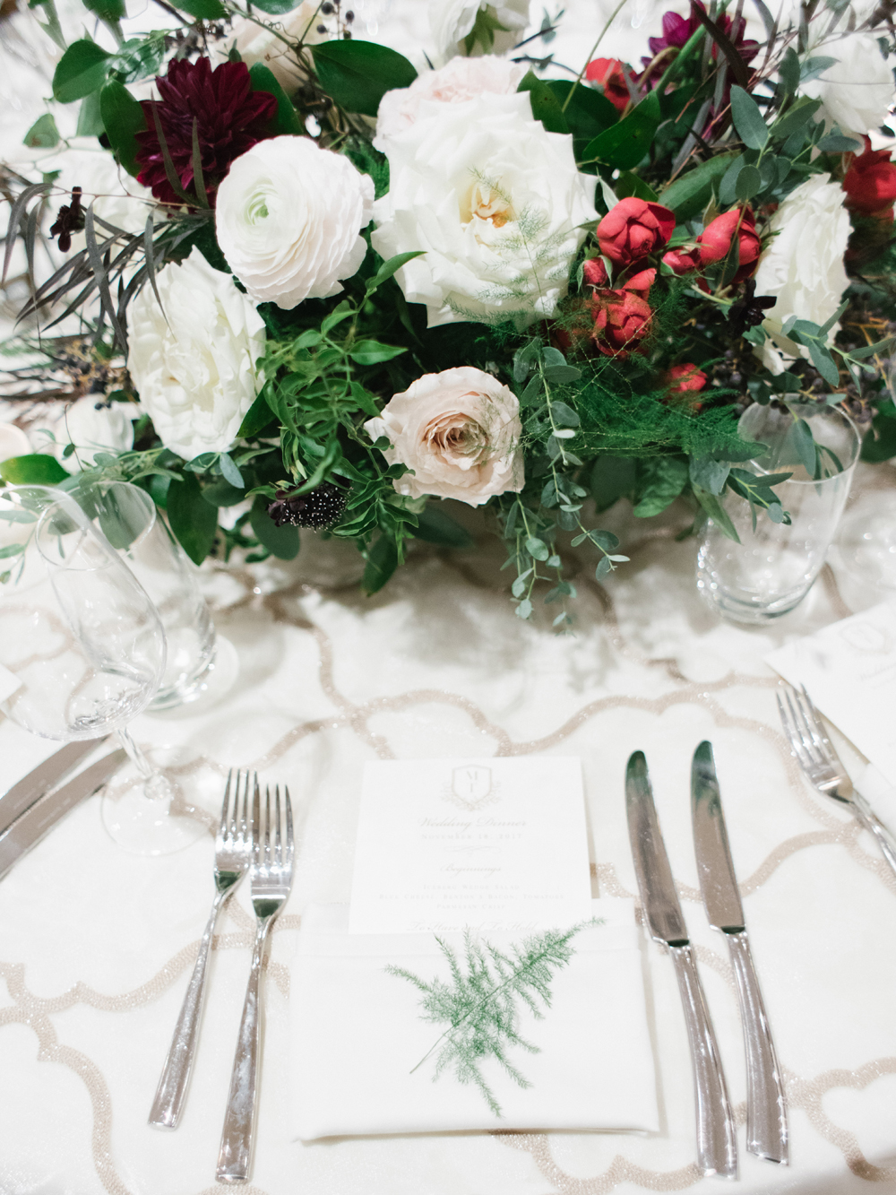 Airy greenery sprig for each place setting