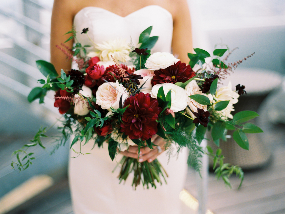 Loose, airy bridal bouquet with dahlias and garden roses in shades of burgundy and cream // Nashville Wedding Floral Design