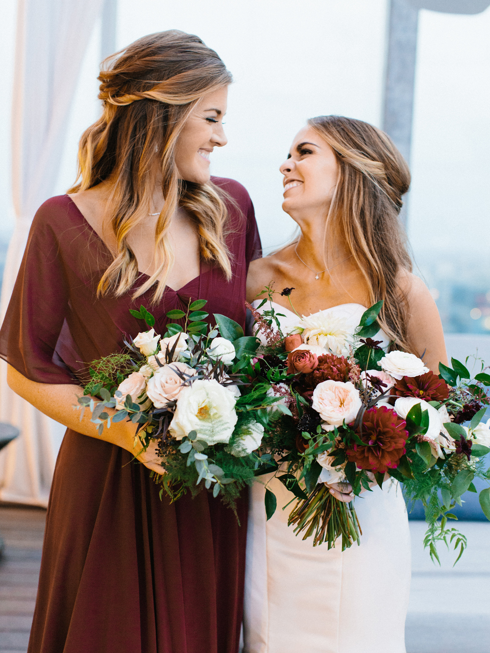 Loose, airy bridal bouquet with dahlias and garden roses in shades of burgundy and cream // Nashville Wedding Florist