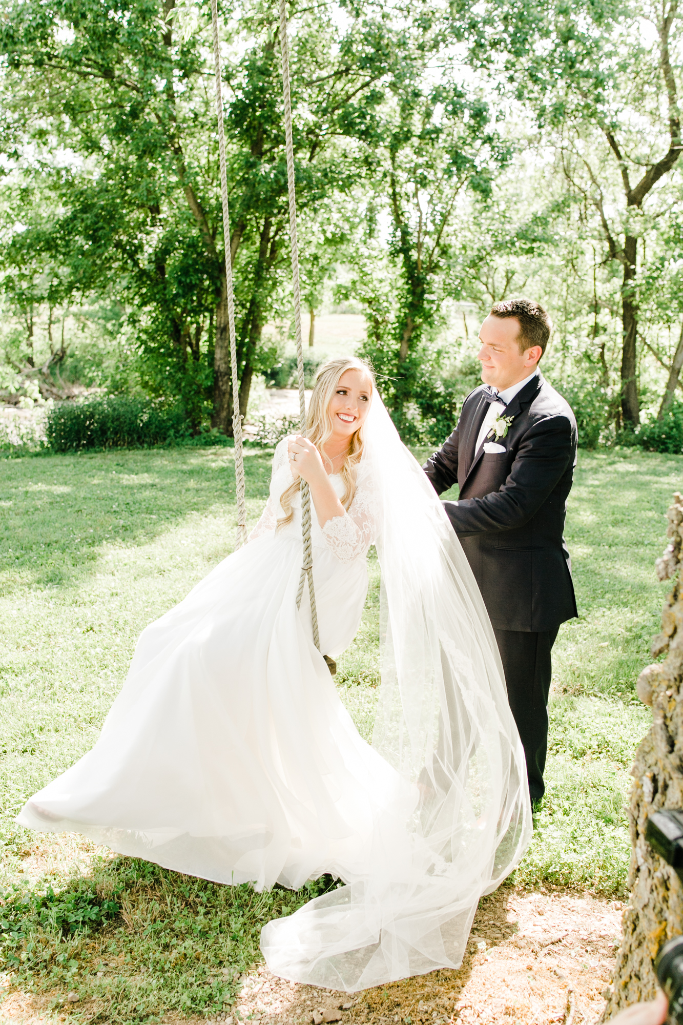 Bride and groom portraits at the tree swing // Floral Design at Long Hollow Gardens