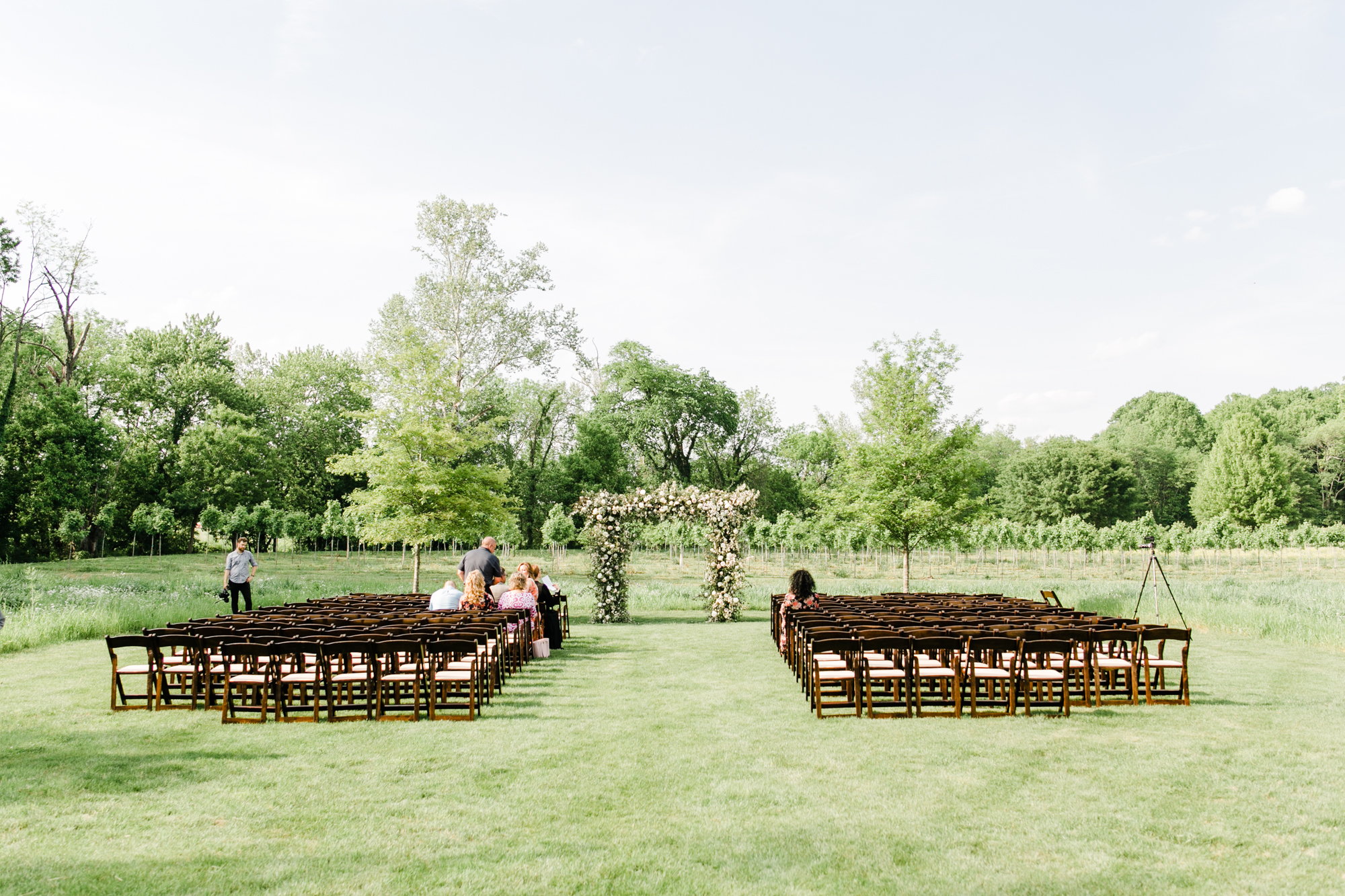 Lush garden arch in a field for the wedding ceremony // Nashville Wedding Florist