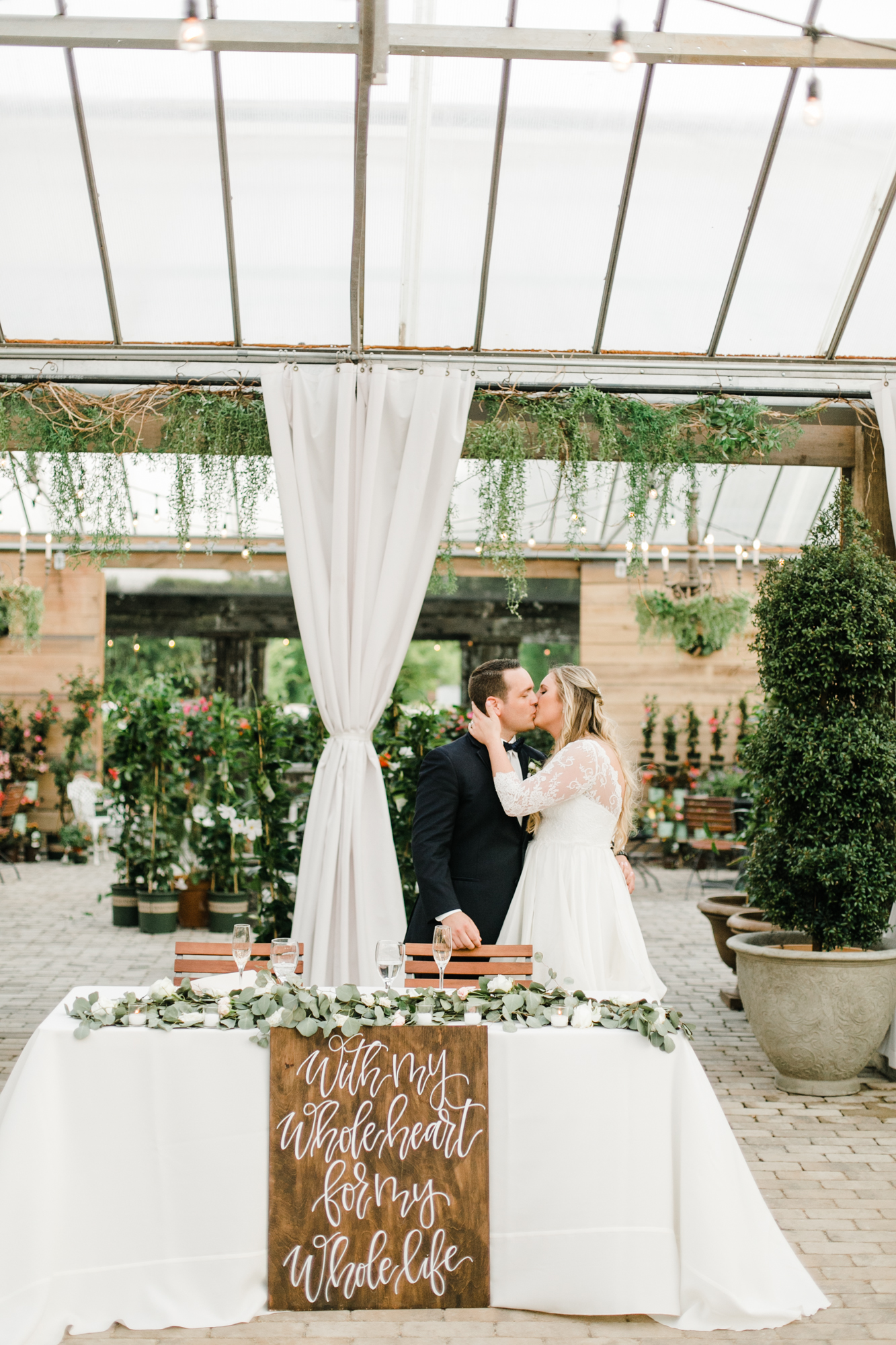 Sweetheart table with lush eucalyptus garland // Nashville Wedding Florist
