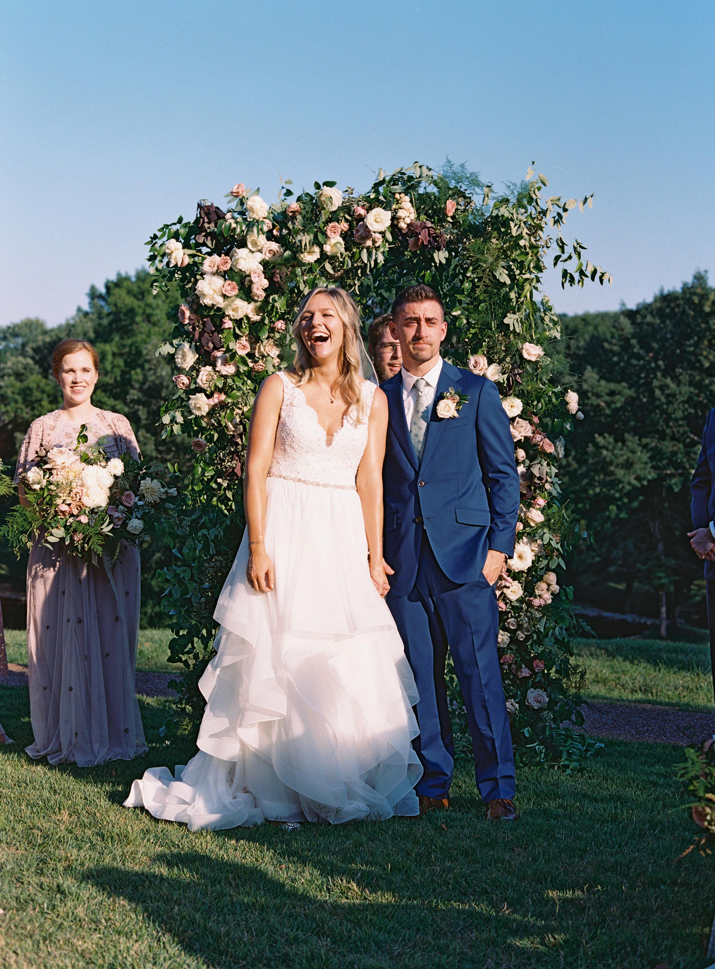 Lush wedding ceremony arch with neutral florals // Nashville, TN and Southeastern Wedding Floral Designer