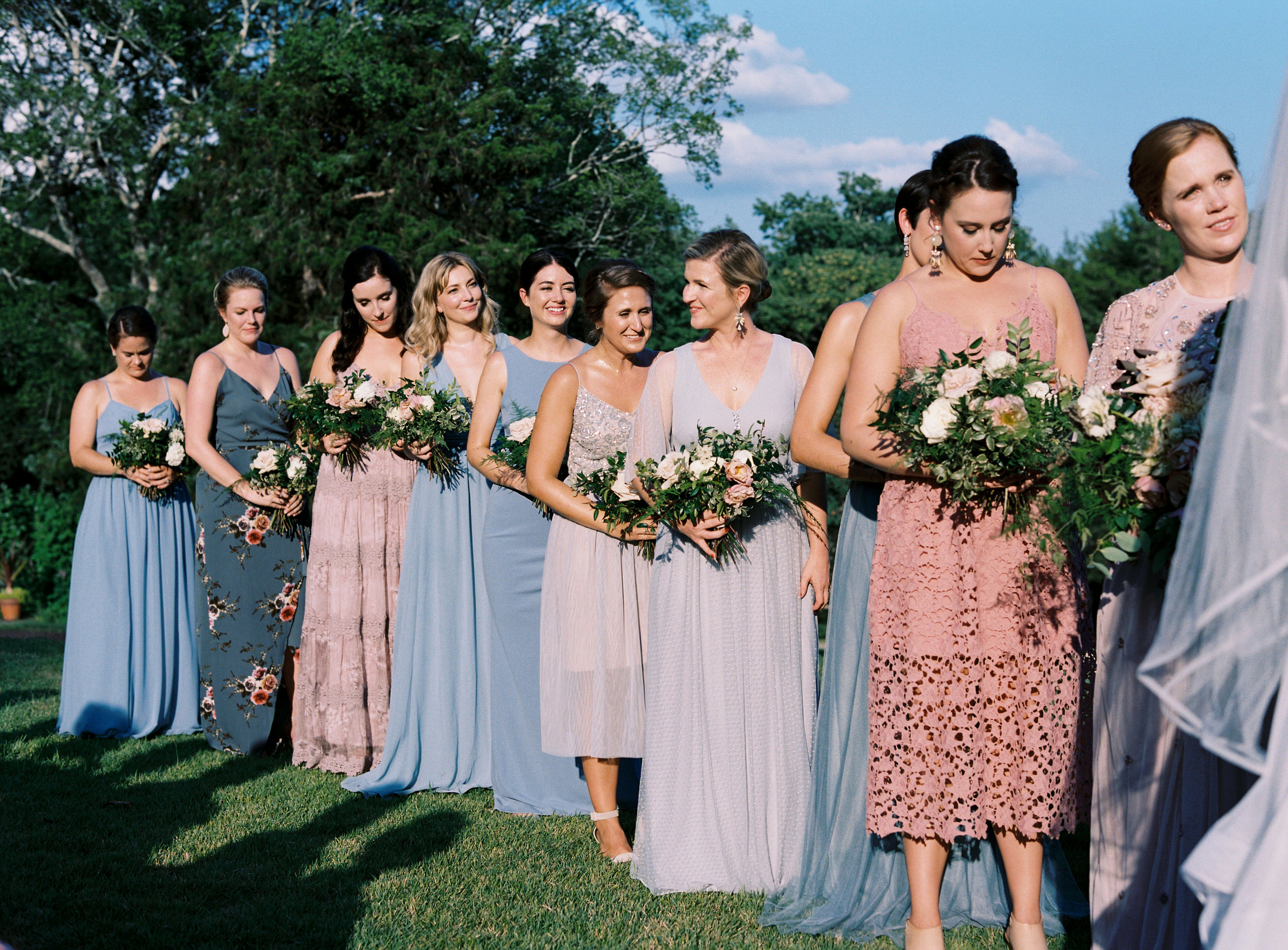 Bridesmaid dressed in varying shades of dusty blue and blush // Nashville, TN and Southeastern Wedding Floral Designer