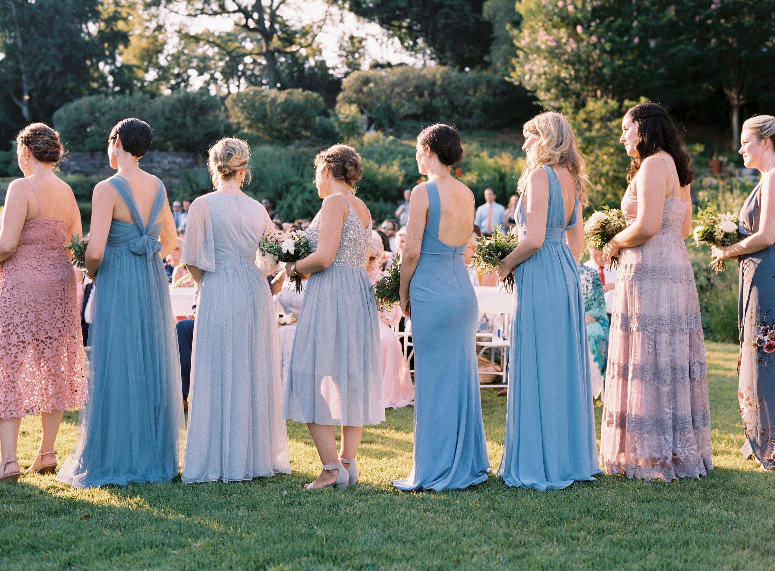 Bridesmaid dressed in soft blues and dusty pinks // Nashville Botanical Garden Wedding