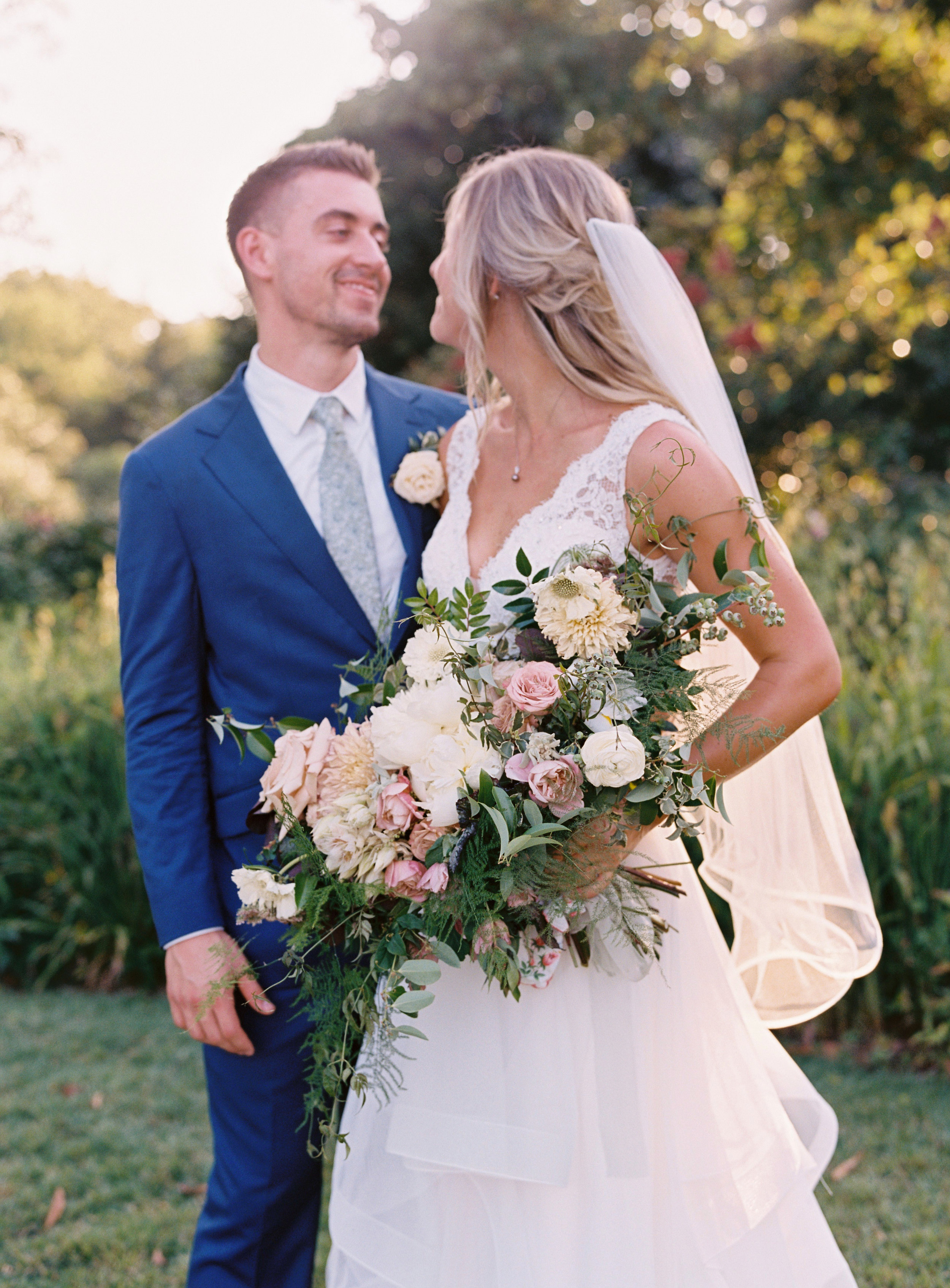 Garden inspired bridal bouquet with cafe au lait dahlias, garden roses, peonies, ranunculus, and trailing greenery // Nashville Wedding Floral Design
