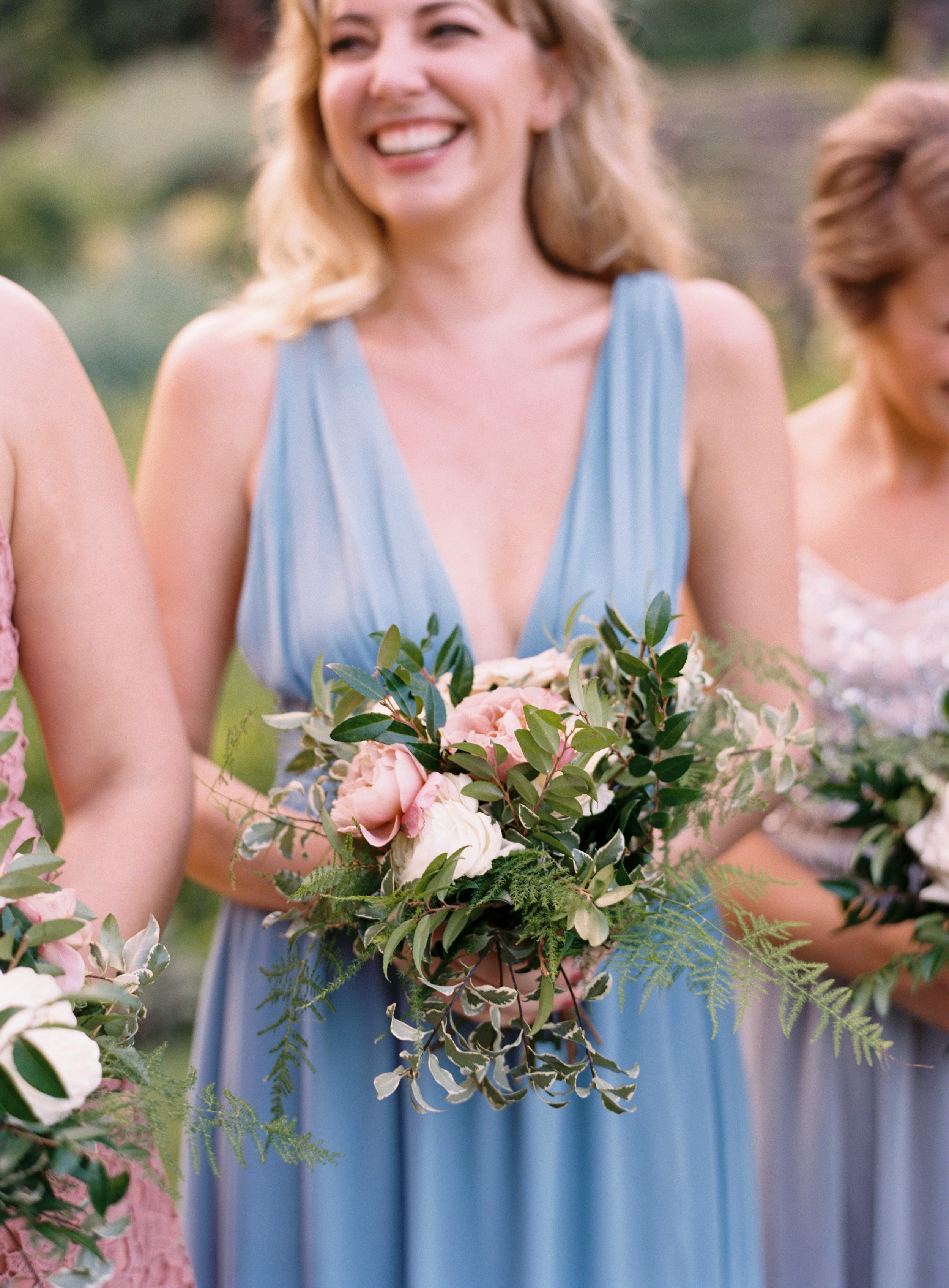 Dusty blue and soft pink bridesmaid dresses with lush, greenery heavy bouquets // Southern US Wedding Florist