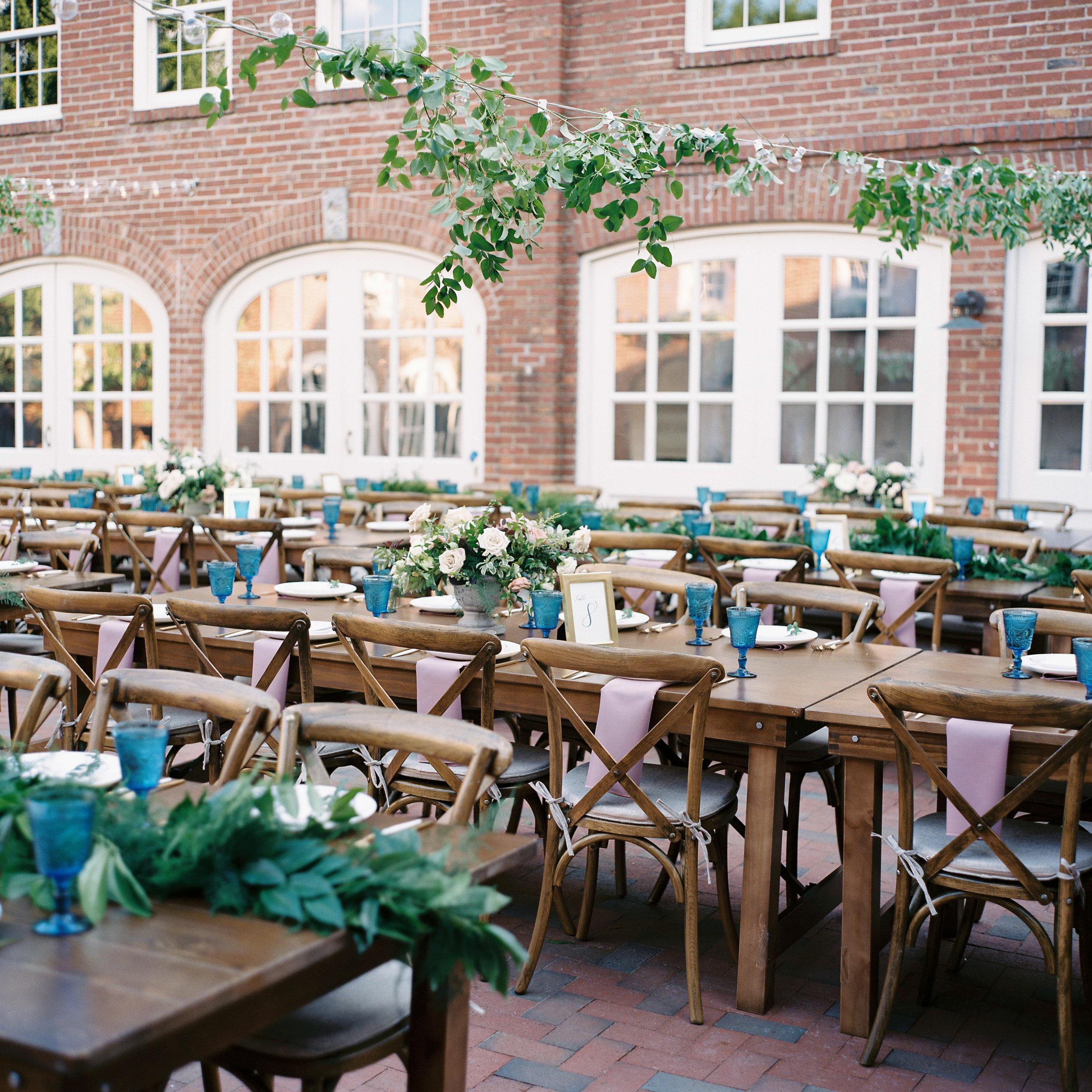 Cheekwood Courtyard Wedding with string lights with vine-like greenery // Nashville Wedding Floral Designer
