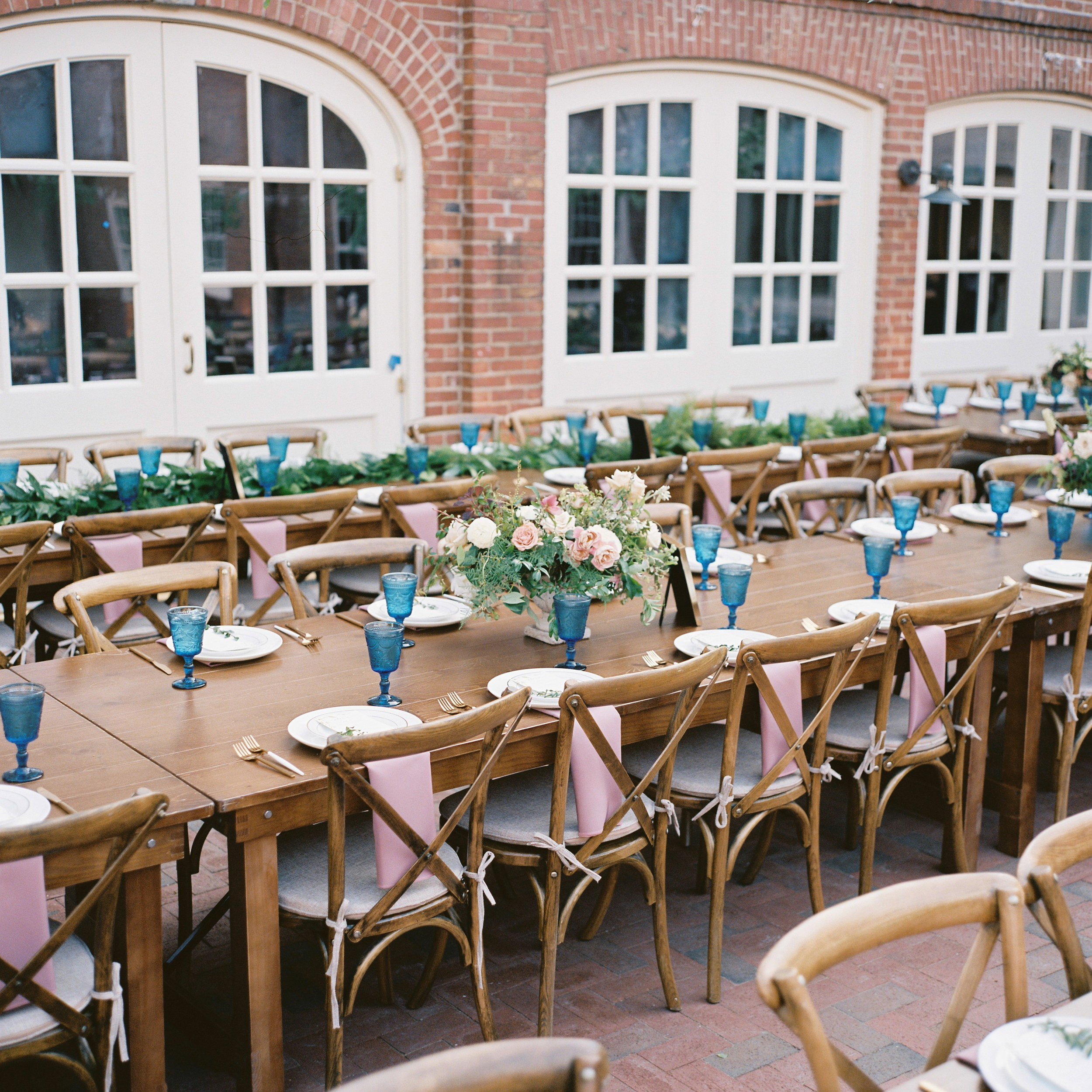 Wooden Farm Table with garden urns centerpieces // Southeastern Floral Design