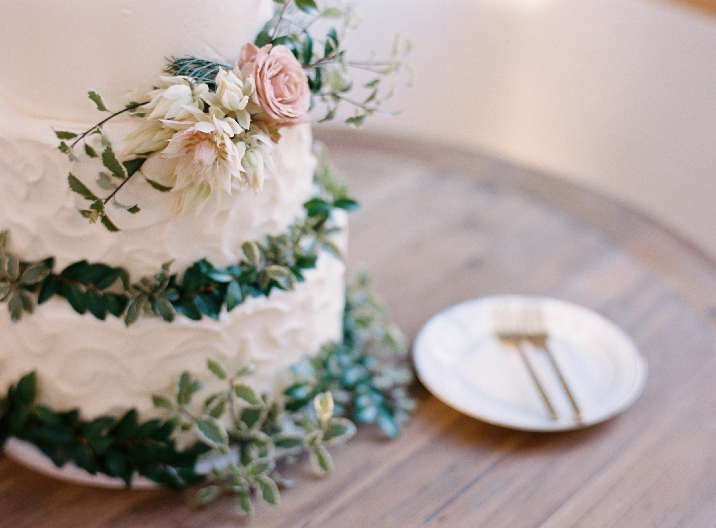 Bride's cake with greenery and floral accents // Nashville Wedding Florist