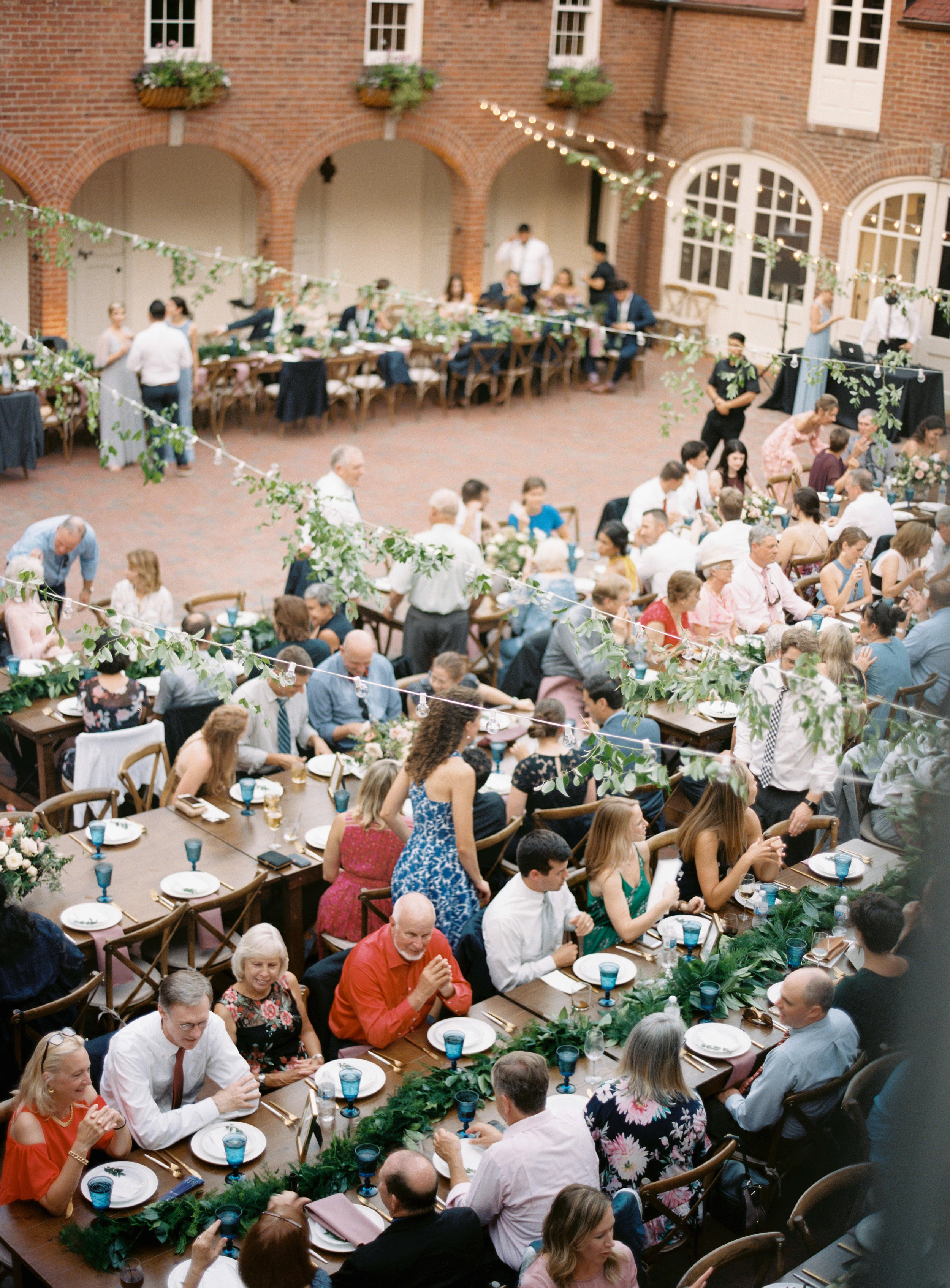 Cheekwood Frist Learning Center Wedding Reception with strings lights and trailing greenery // Nashville Wedding Florist