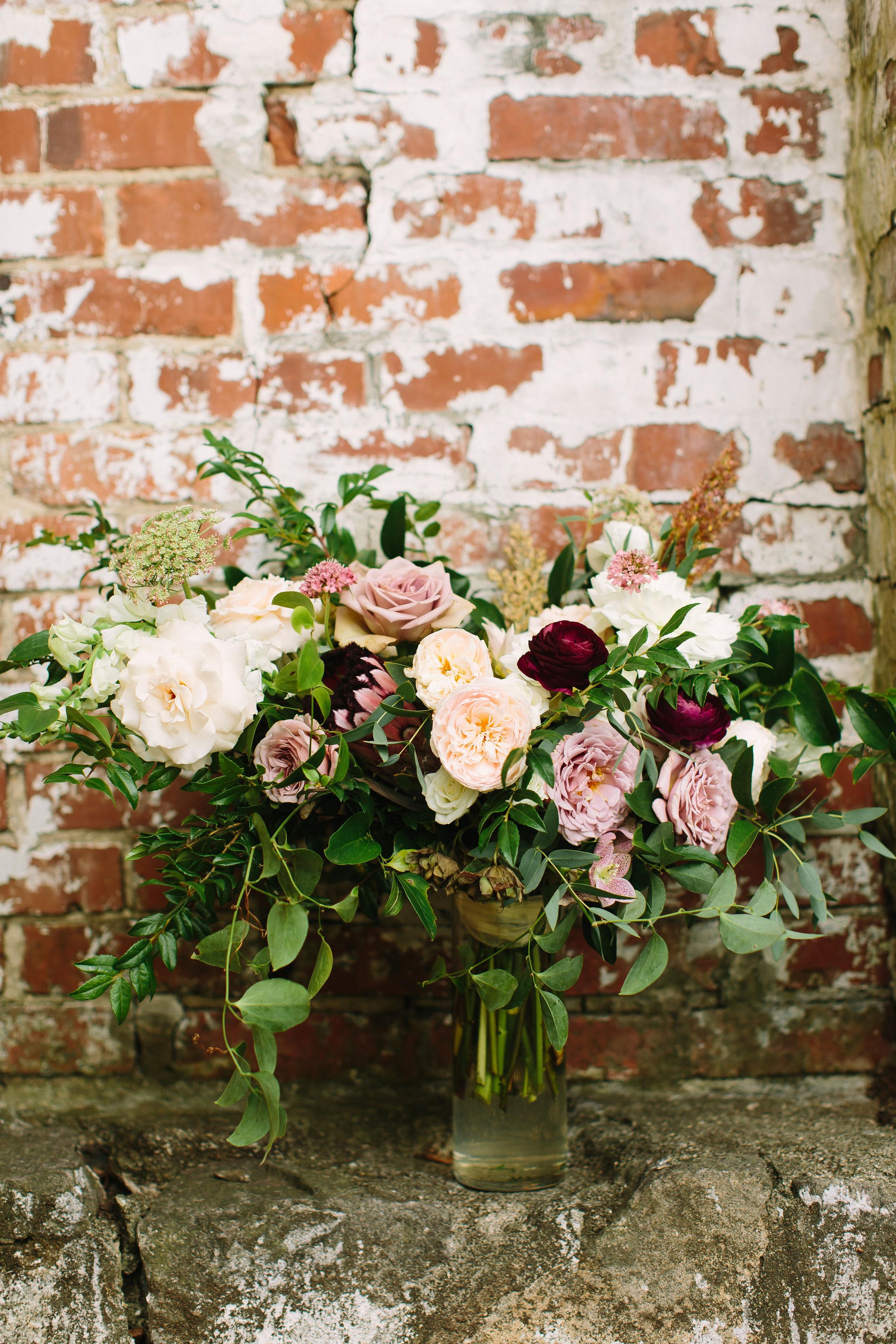 Lush, untamed bridal bouquet in shades of dusty mauve, ivory, blush, and greenery // Nashville Wedding Florist