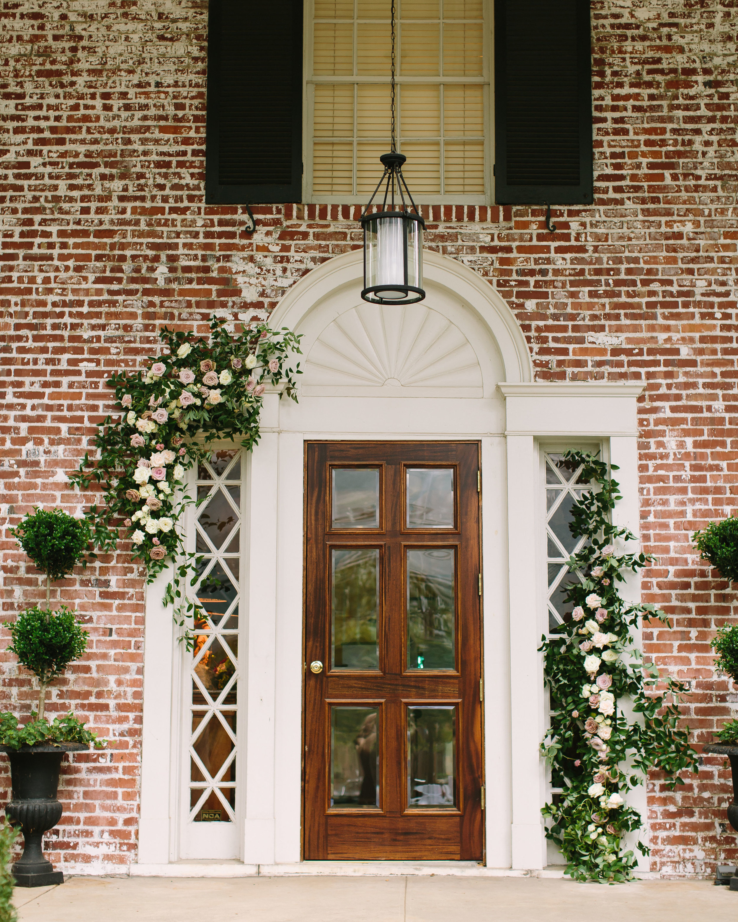 Natural floral installation on doorway // Belle Mead Backyard Wedding