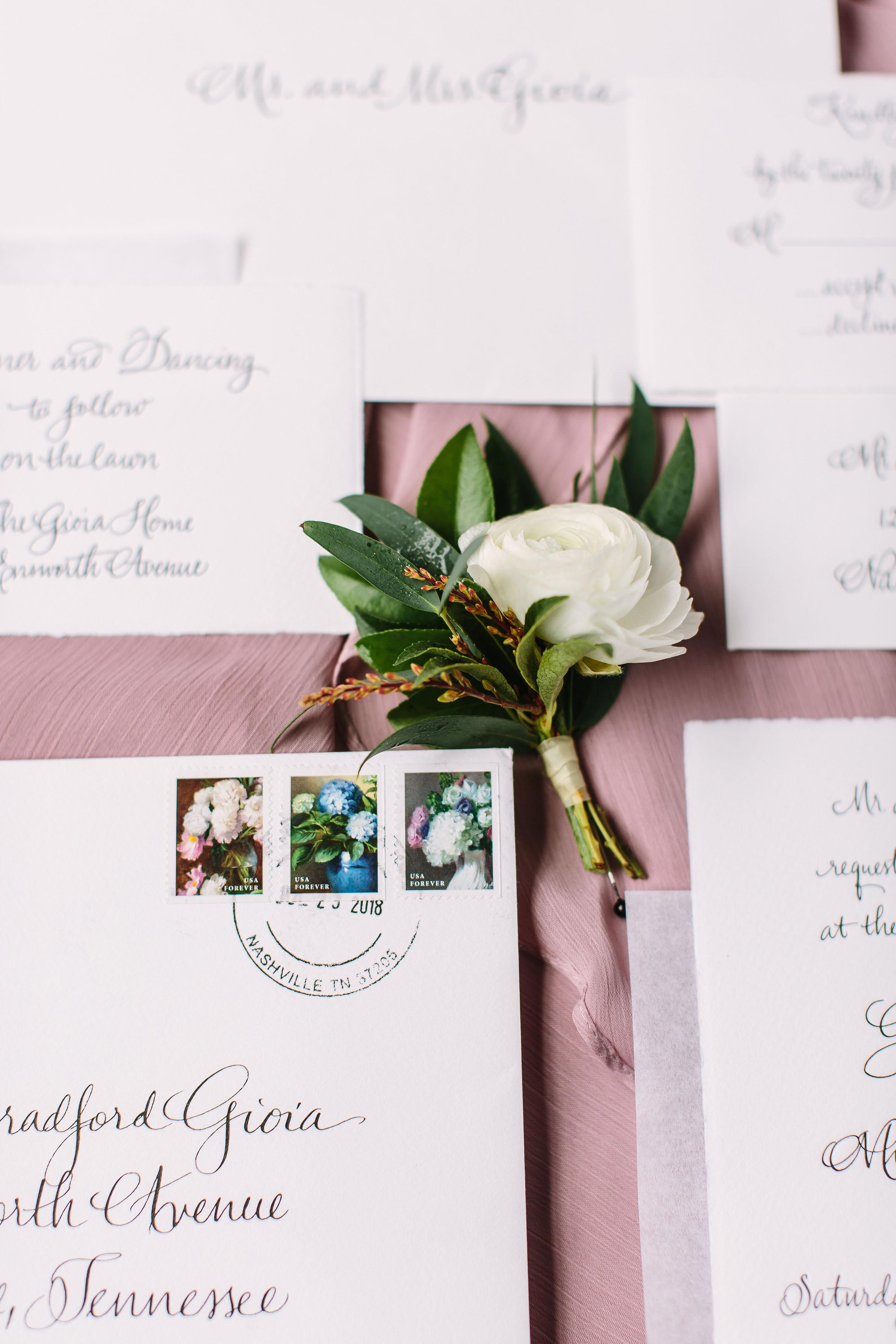 White ranunculus and greenery boutonniere // Nashville Wedding Floral Design
