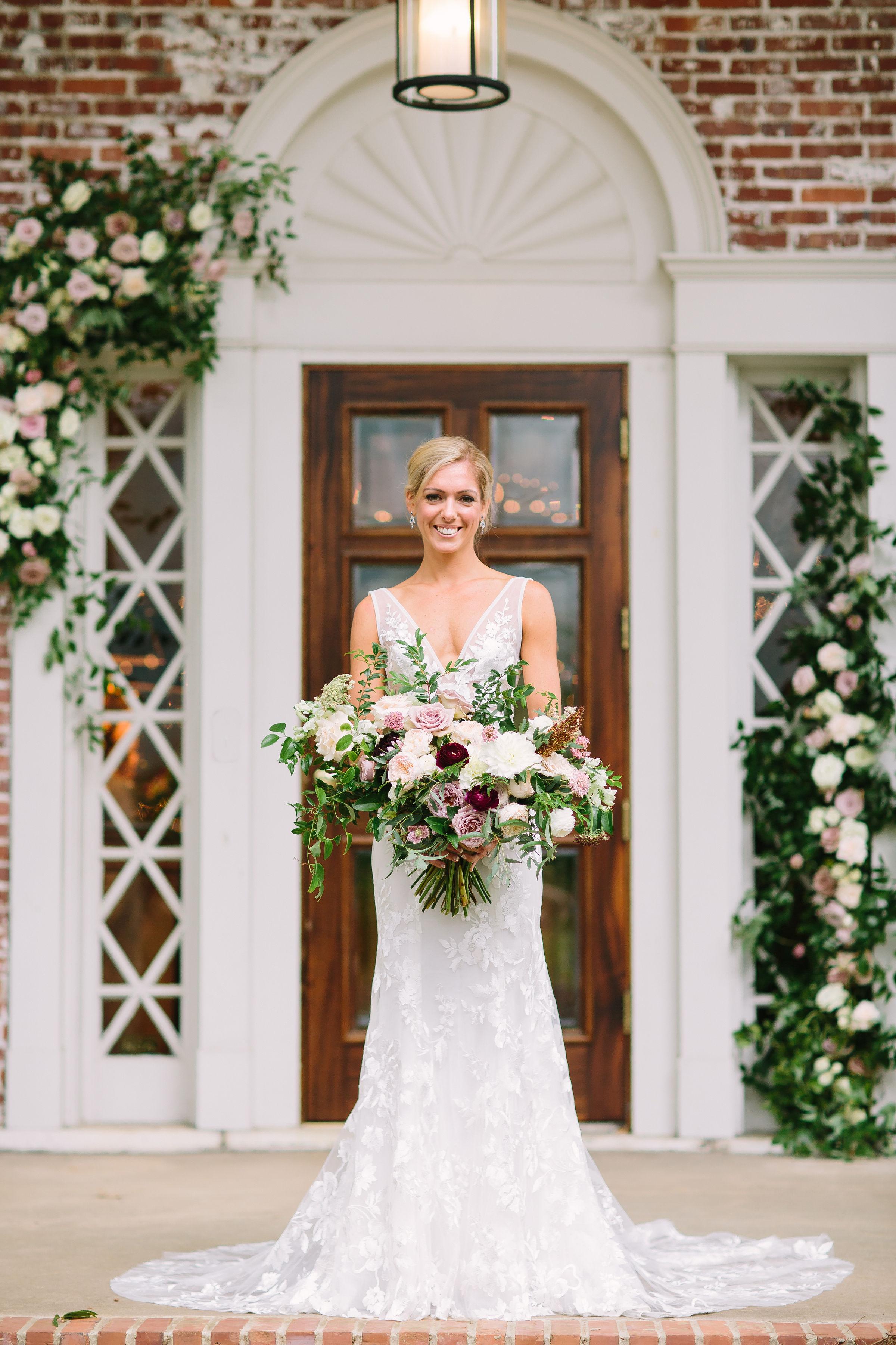 Natural, asymmetrical bridal bouquet with soft mauve garden roses, eggplant ranunculus, and trailing greenery // Nashville, TN Floral Designer