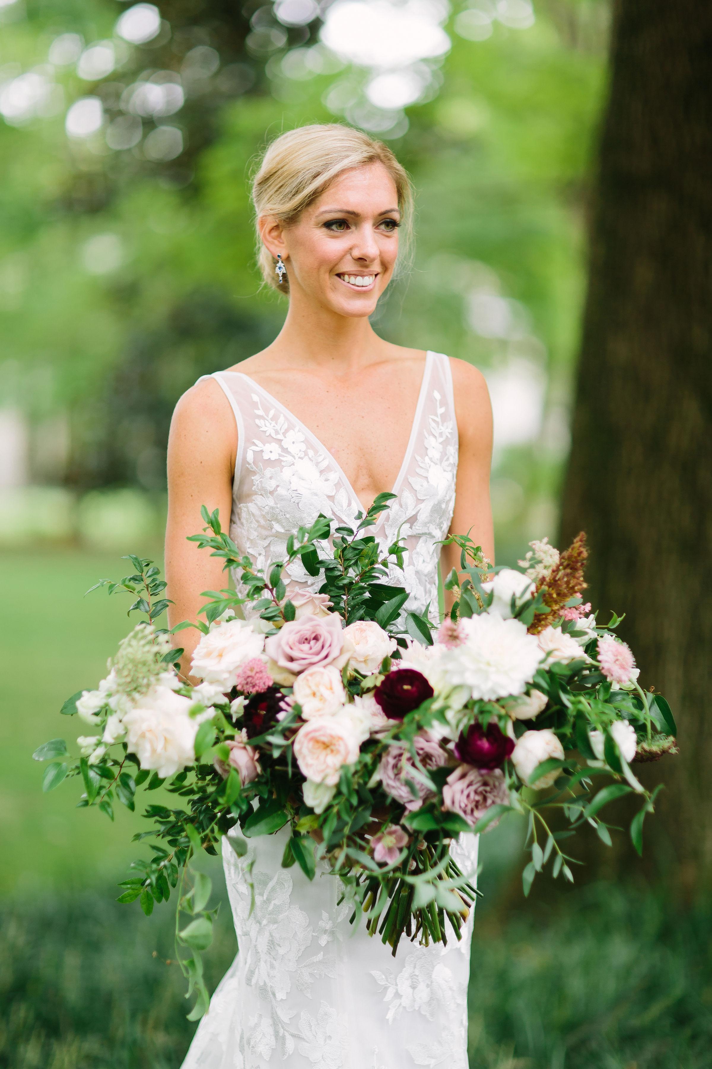 Lush, garden-inspired bridal bouquet with garden roses, ranunculus, and dahlias // Nashville Wedding Florist