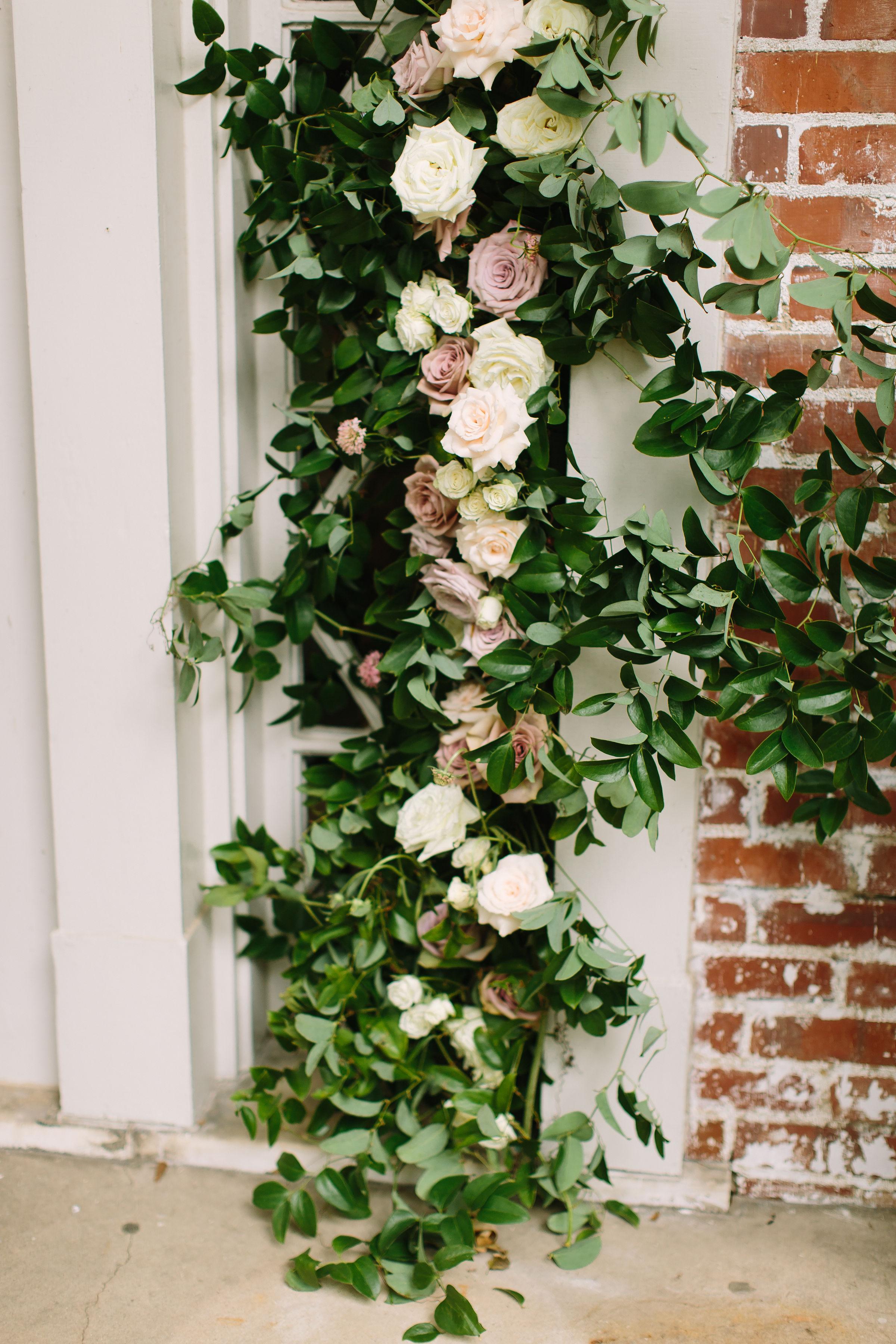 Garden-inspired floral installation on the front door // Nashville Backyard Wedding Floral Design