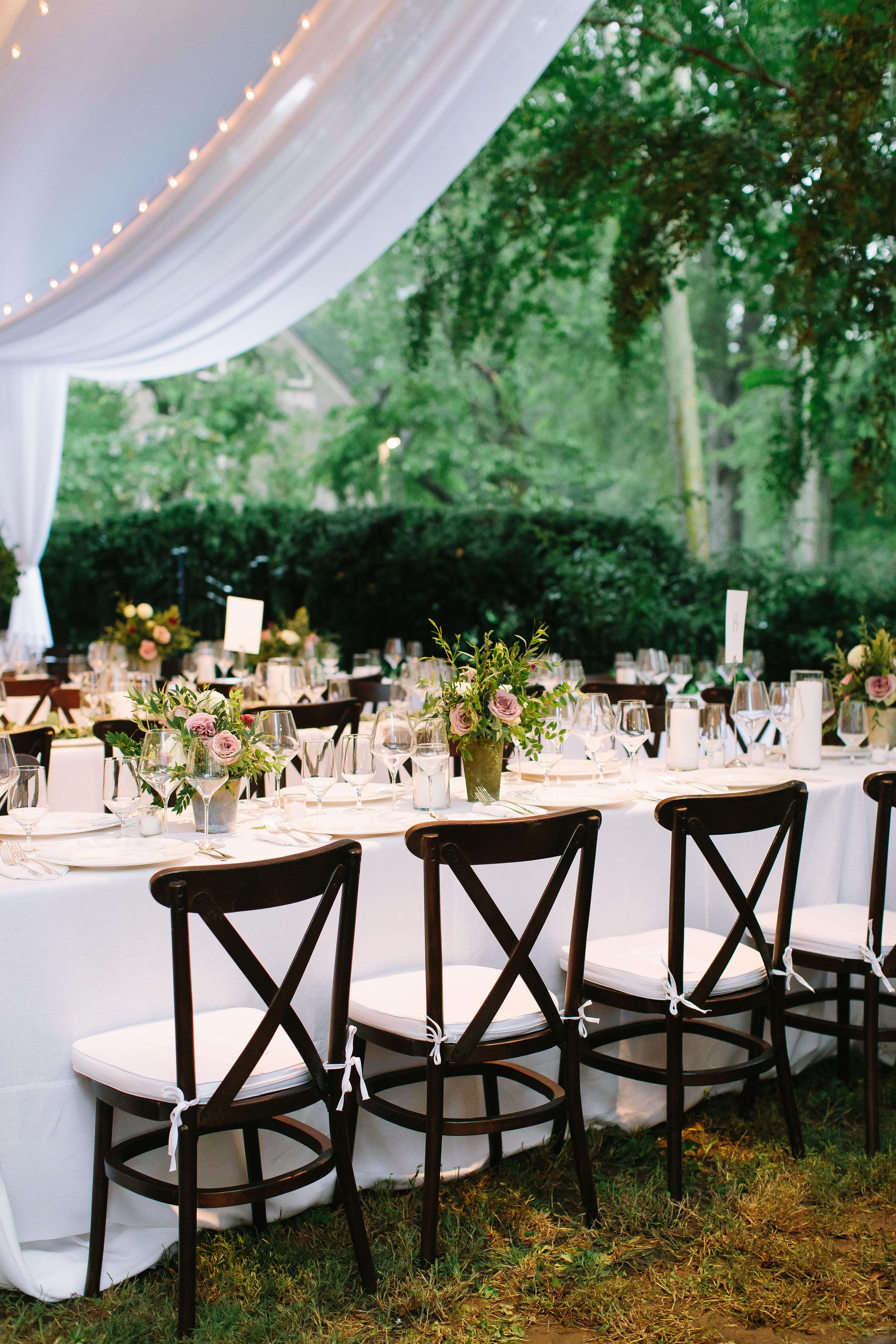 Lush, natural centerpiece of garden roses, ranunculus, and greenery // Nashville Backyard Wedding Flowers