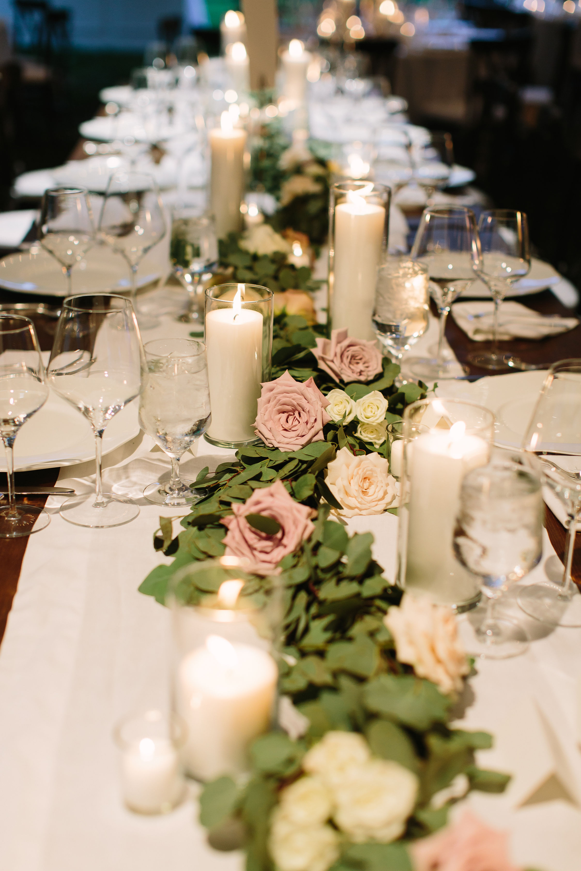 Head table greenery garland with floral accents of soft mauve and cream roses // Tennessee Floral Design