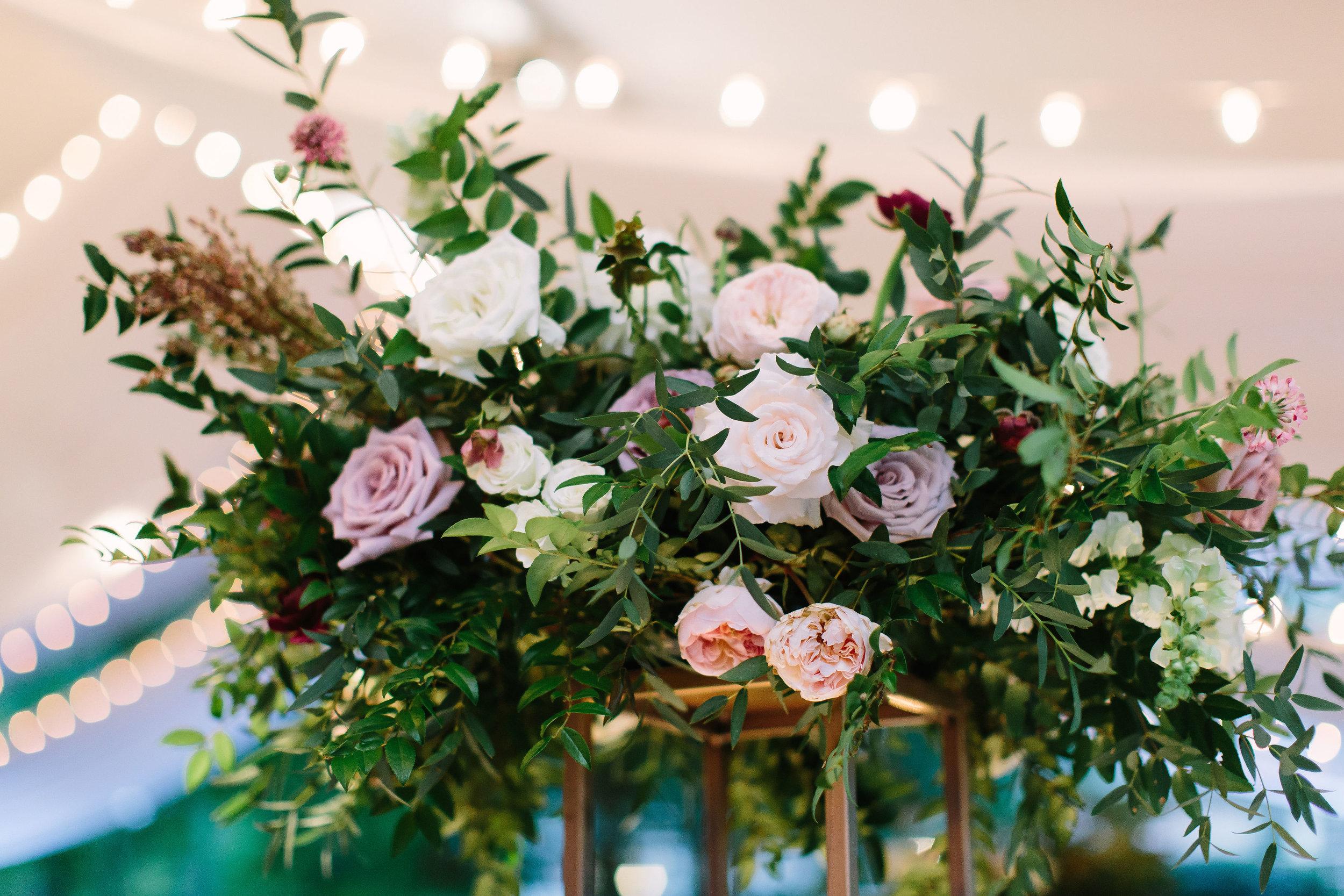 Organic, garden-inspired floral centerpiece of garden roses, ranunculus, and lush greenery // Nashville Wedding Florist
