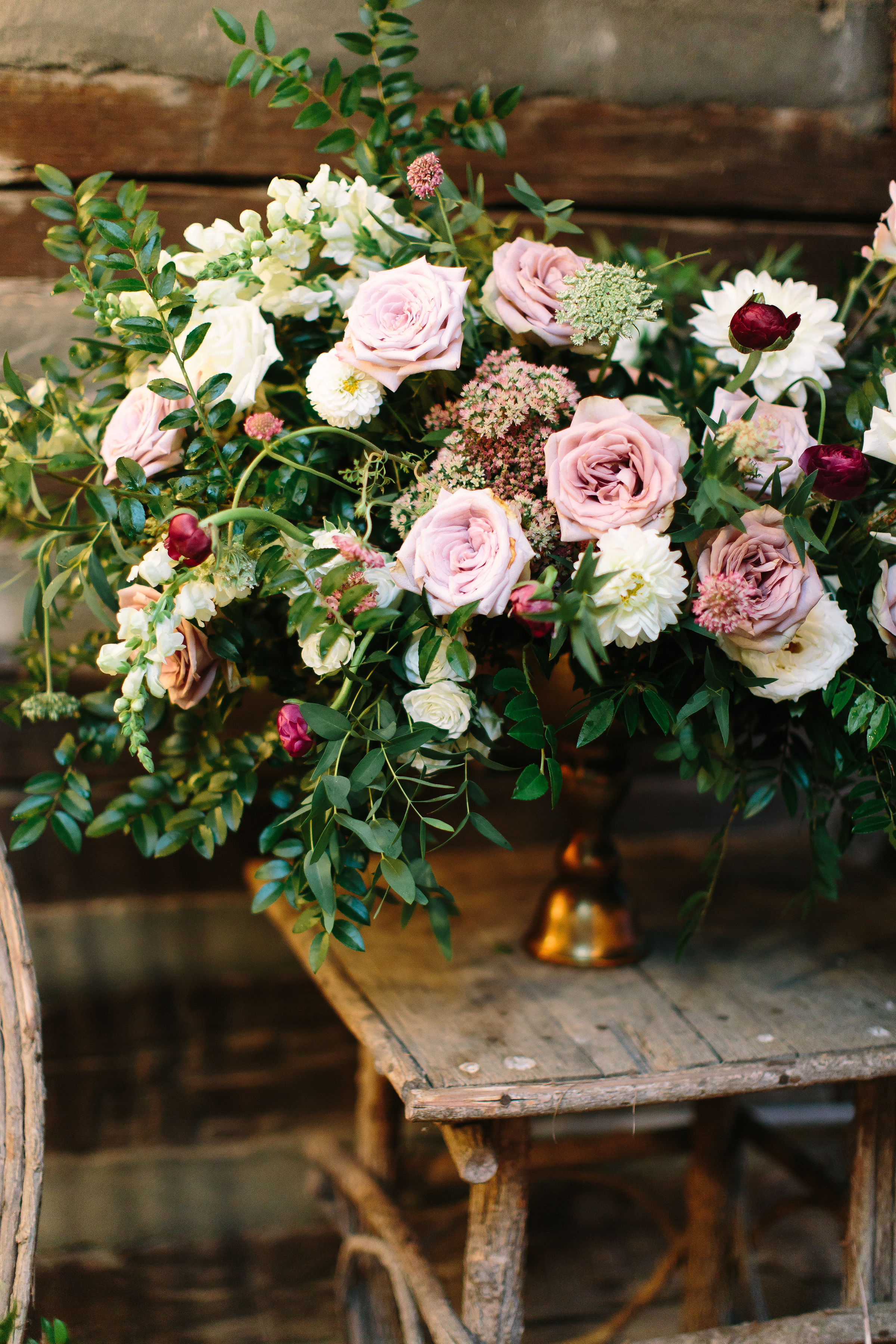 Large floral arrangement in hues of dusty mauve, blush, and ivory with asymmetrical, untamed greenery // Nashville, TN Floral Design