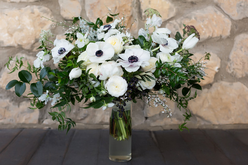 Lush all white and greenery bridal bouquet with anemones, sweet peas, garden roses, and tulips // Nashville Wedding Flowers