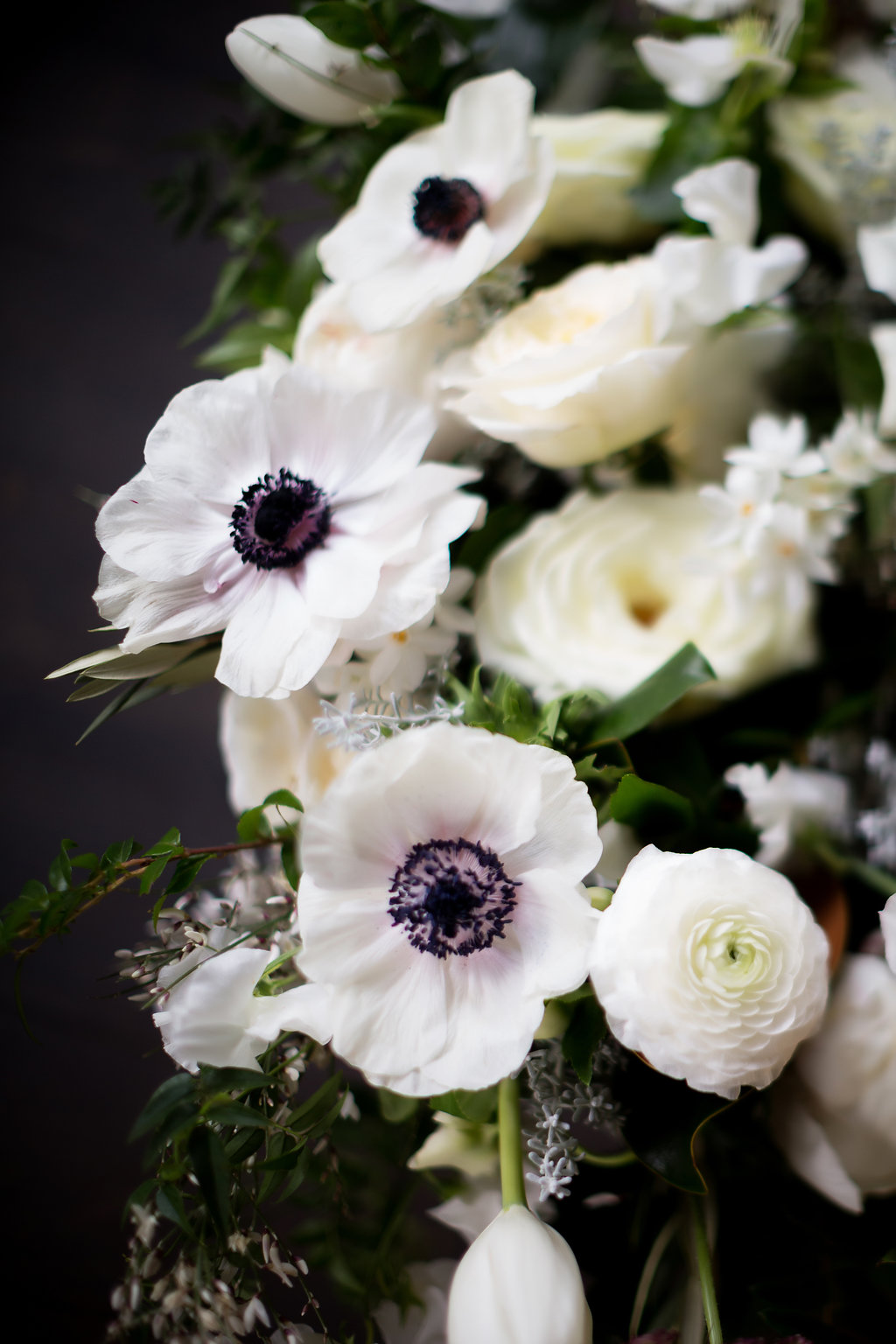 Lush all white and greenery bridal bouquet with anemones, sweet peas, garden roses, and tulips // Blackberry Farm Wedding Florist