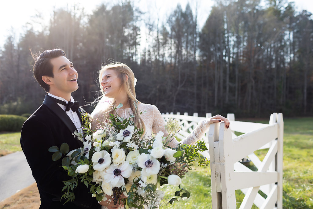 Lush all white and greenery bridal bouquet with anemones, sweet peas, garden roses, and tulips // Tennessee Wedding Florist