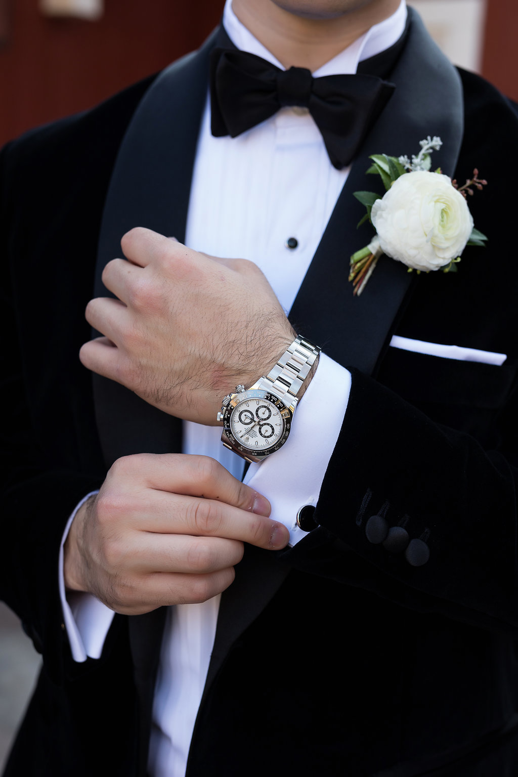 White Ranunculus groom's boutonniere with wintry texture and natural greenery // Blackberry Farm Wedding Florist
