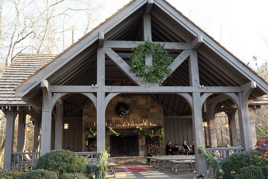 Oversized wreath and lush garlands on the pavilion for the wedding ceremony // Nashville Floral Design