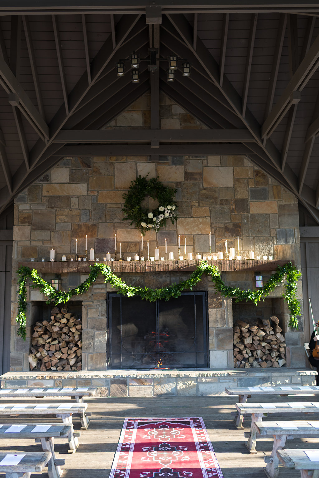 Lush garland, persian rug, and brass candlesticks // Blackberry Farm Wedding Ceremony