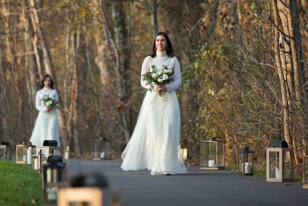 All white bridesmaid style with cashmere turtlenecks, tulle skirts, and loose bouquets of white florals and natural greenery // Nashville Wedding Flowers // Rosemary & Finch Floral Design