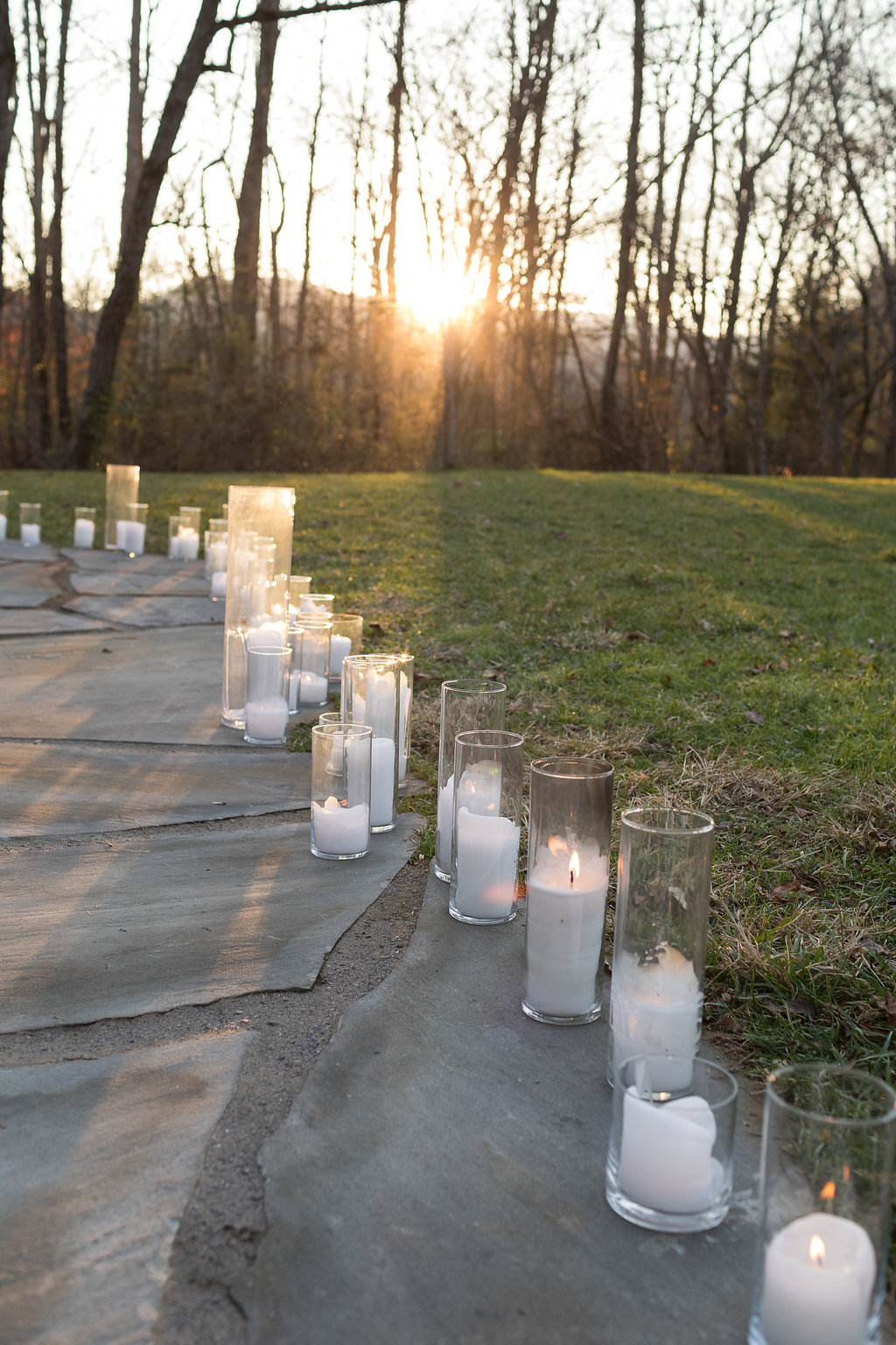 Candles lining the way to the wedding ceremony // Rosemary & Finch Floral Design