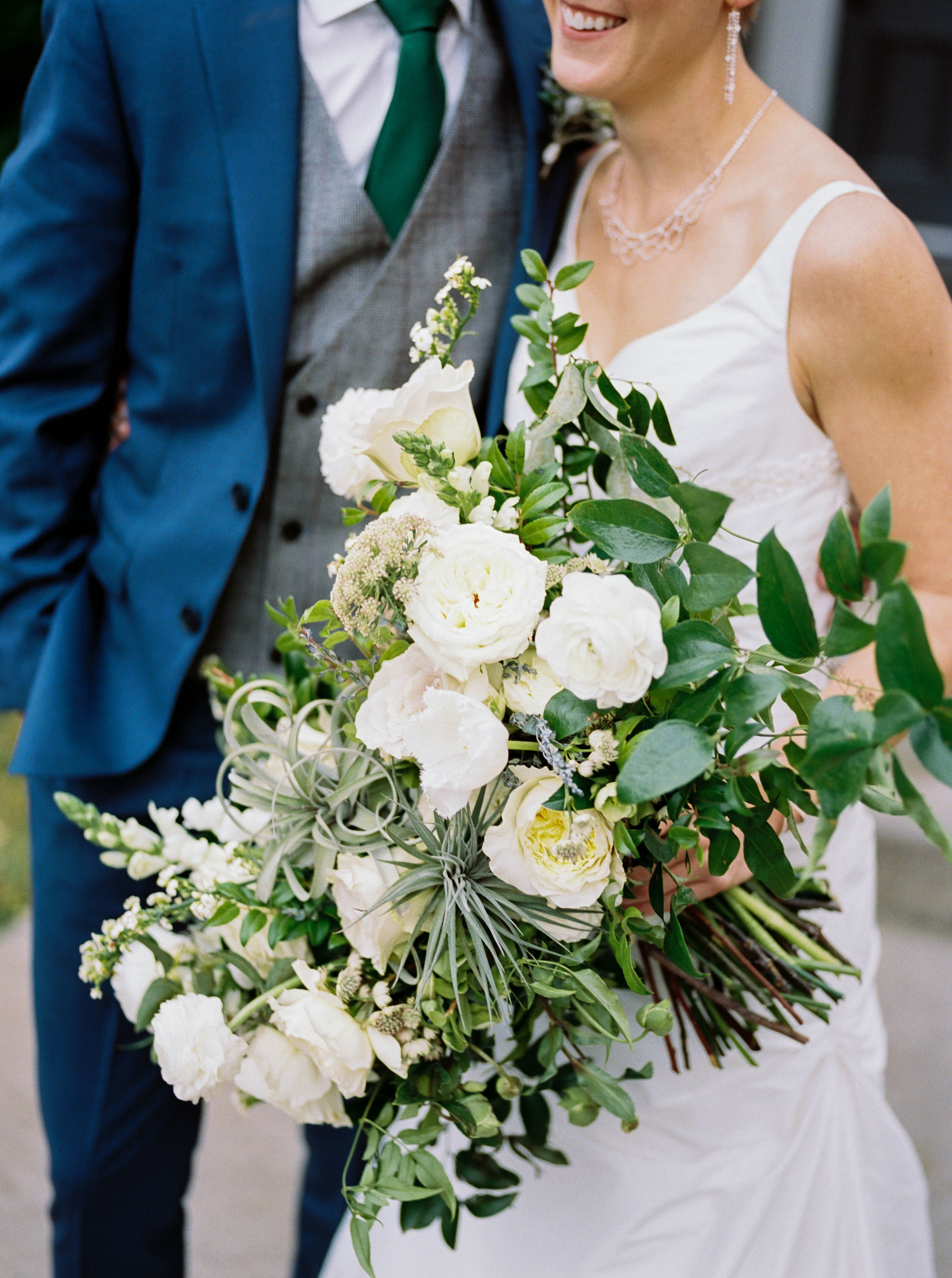 Organic bridal bouquet with garden roses, ranunculus, air plants, and greenery // Nashville, TN Wedding Florist
