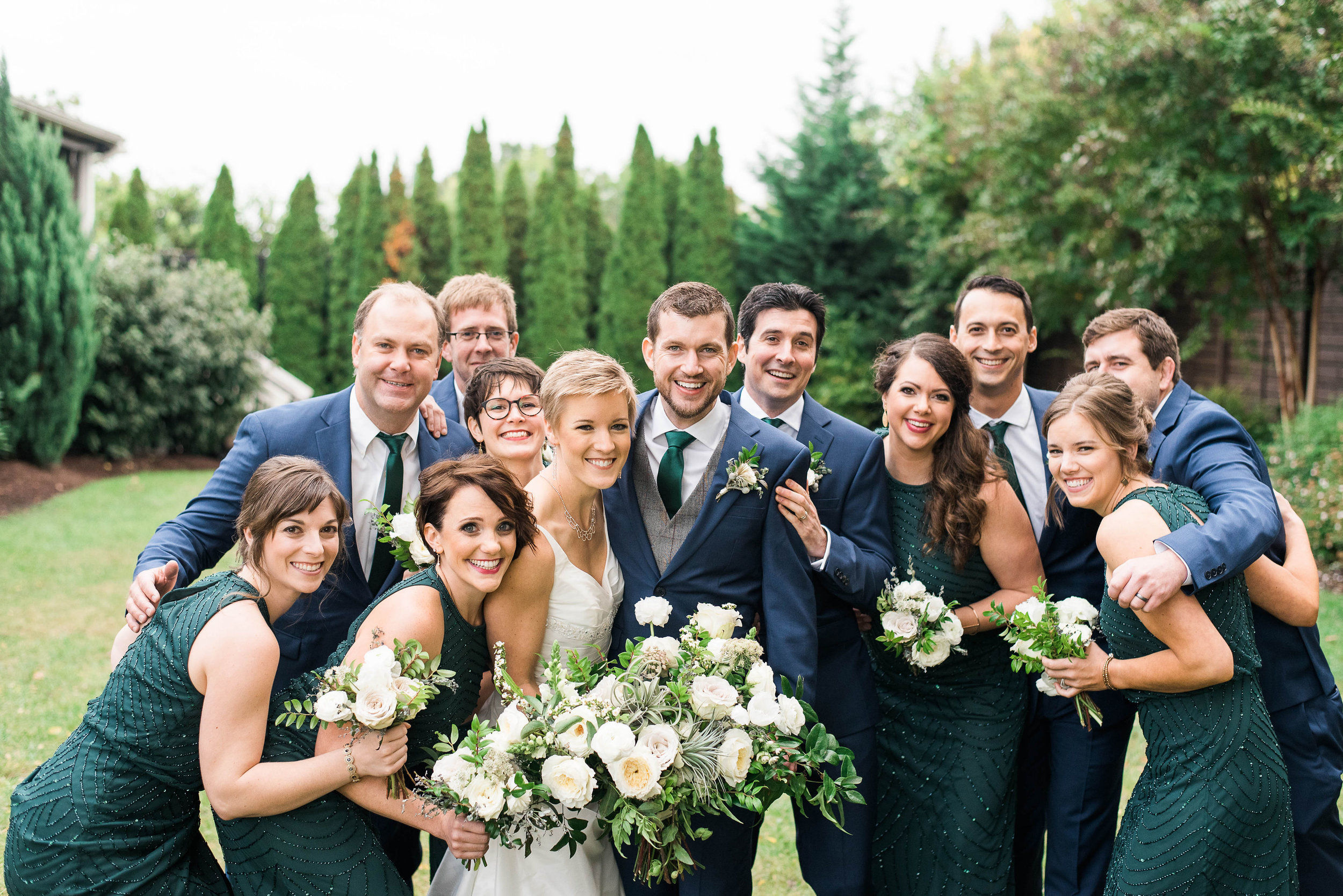Emerald bridesmaid dresses with white and neutral bouquets // Nashville Wedding Flowers