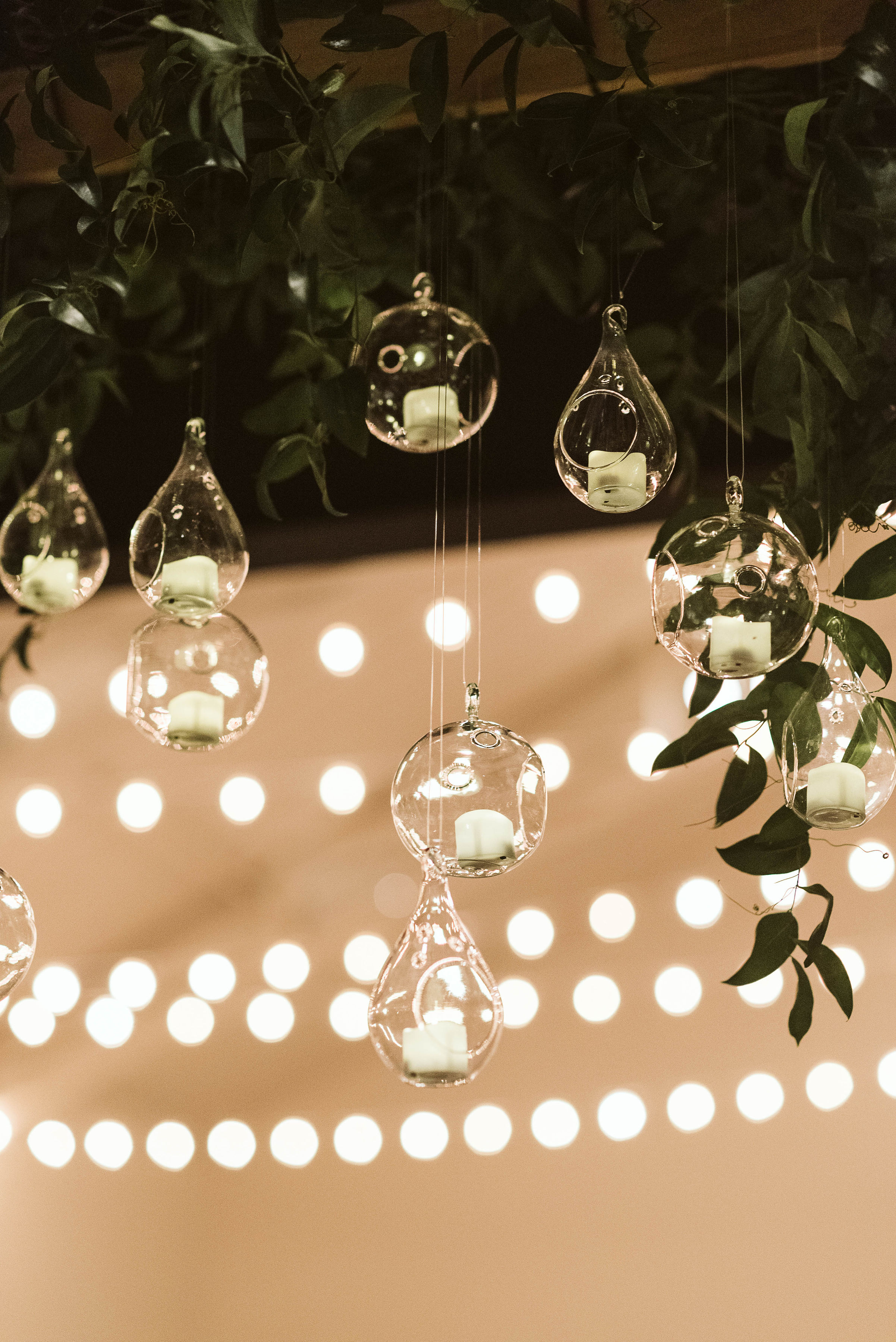 Hanging candle installation with untamed greenery // Tennessee Wedding Floral Design