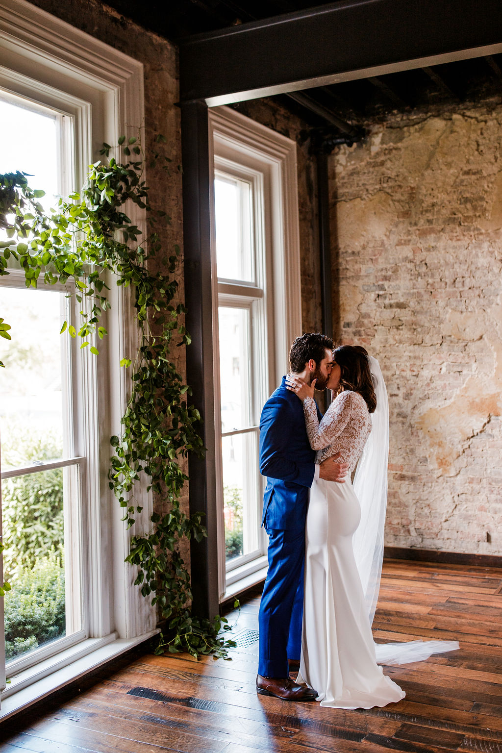 Vine-like greenery arch installation for the ceremony backdrop // Southern US Wedding Floral Designer