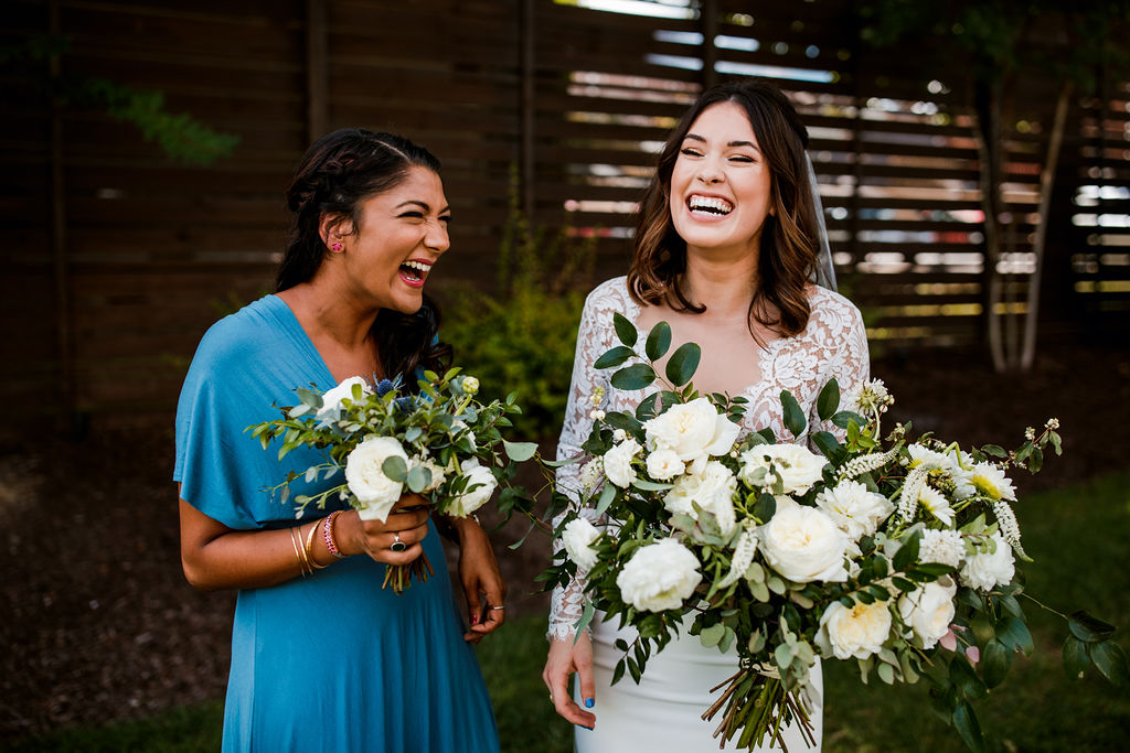 All white and greenery bouquets for bridesmaids in blue dress // Nashville Wedding Flowers