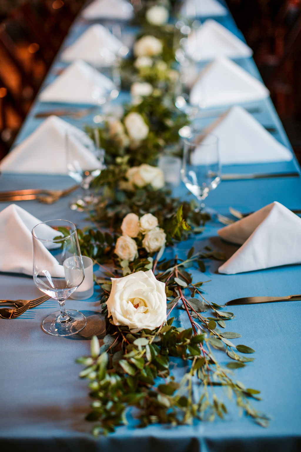 Eucalyptus garland table runners with floral accents of white and blush // TN Floral Designer