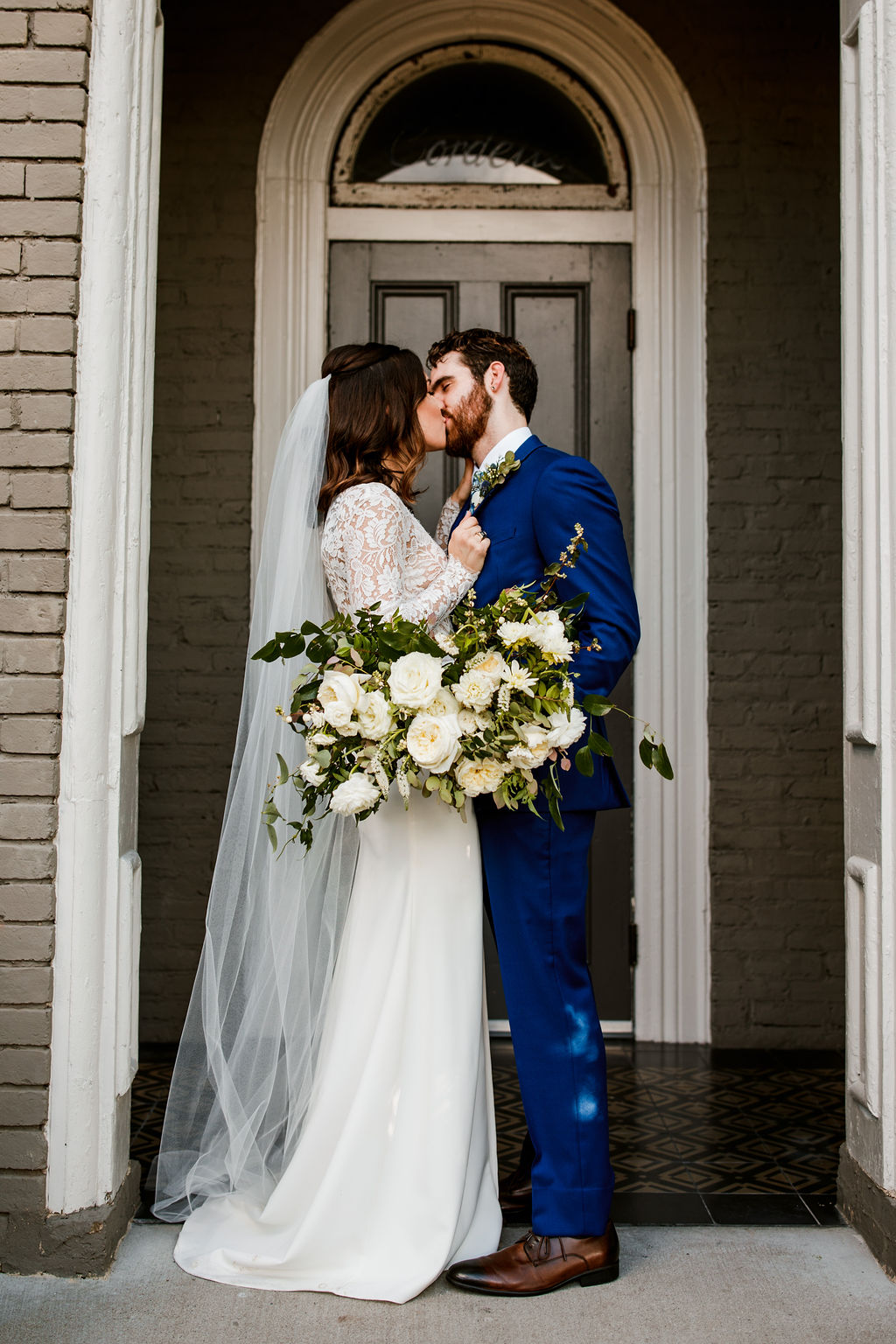 Organic, untamed bridal bouquet with all white flowers and natural greenery // Nashville Wedding Florist