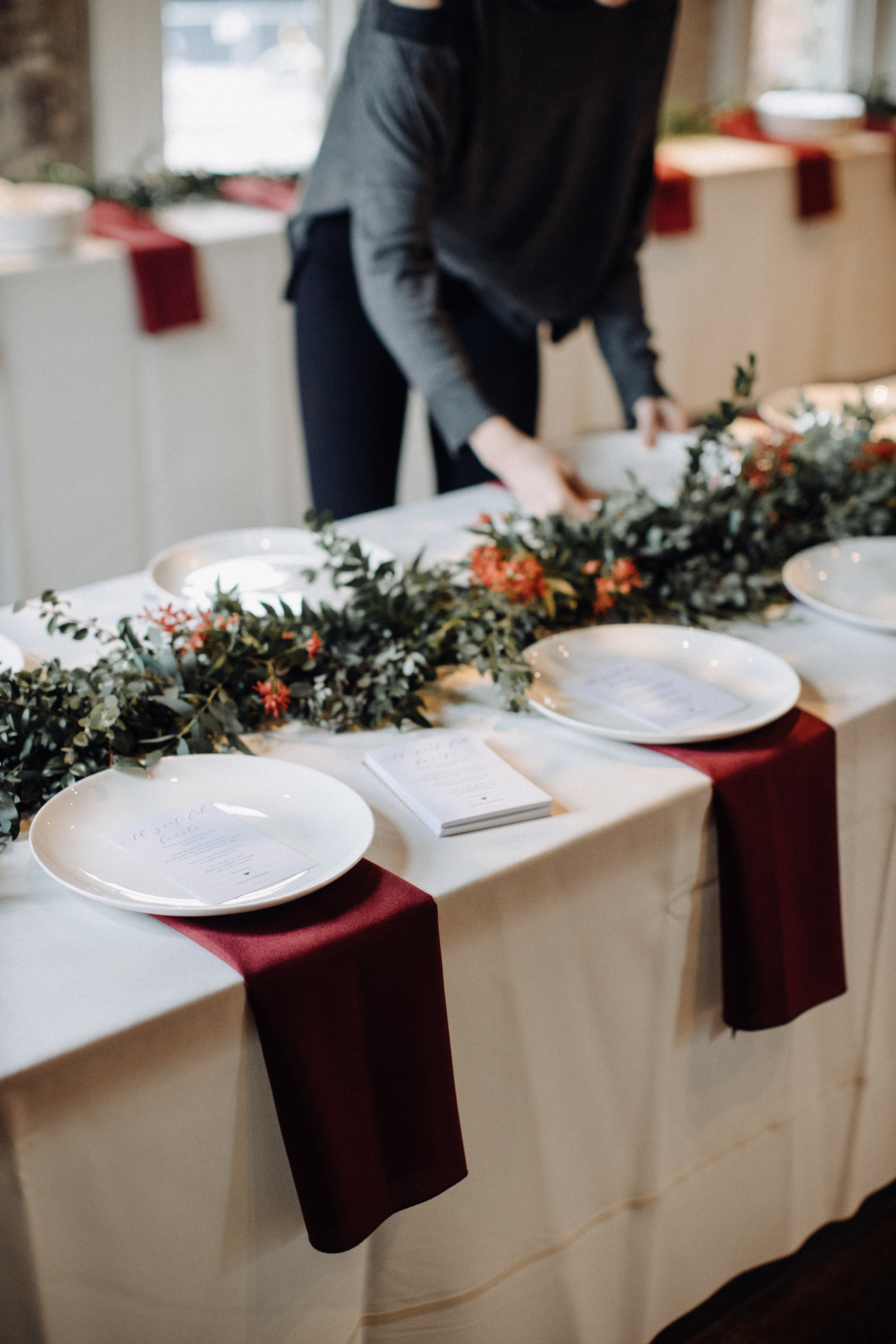 Garland table runner of eucalyptus and natural greenery. Garden-inspired wedding florals at the Cordelle, Nashville.
