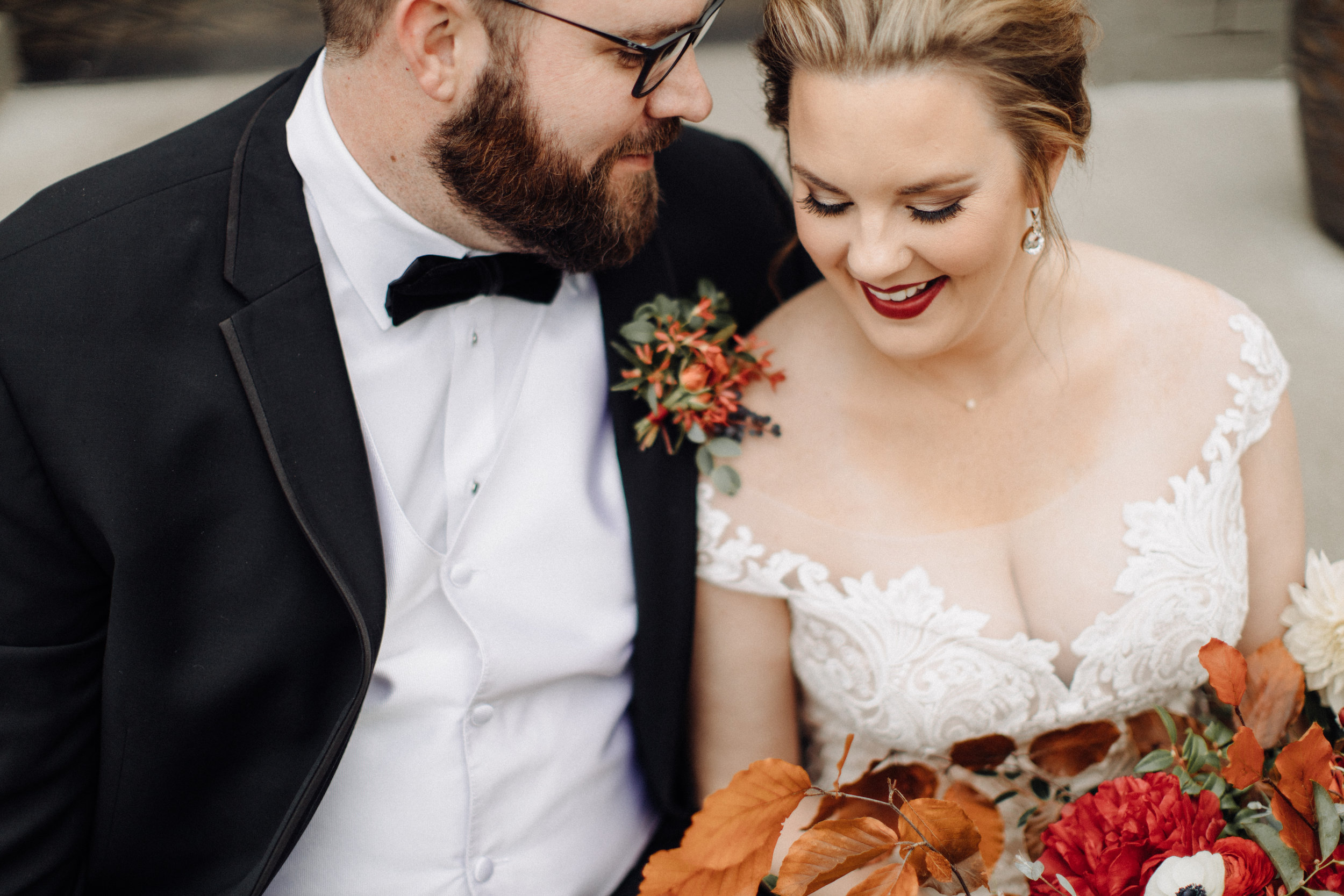Autumnal groom boutonniere with berries, greenery, and texture. Southeastern US Wedding Floral Design.