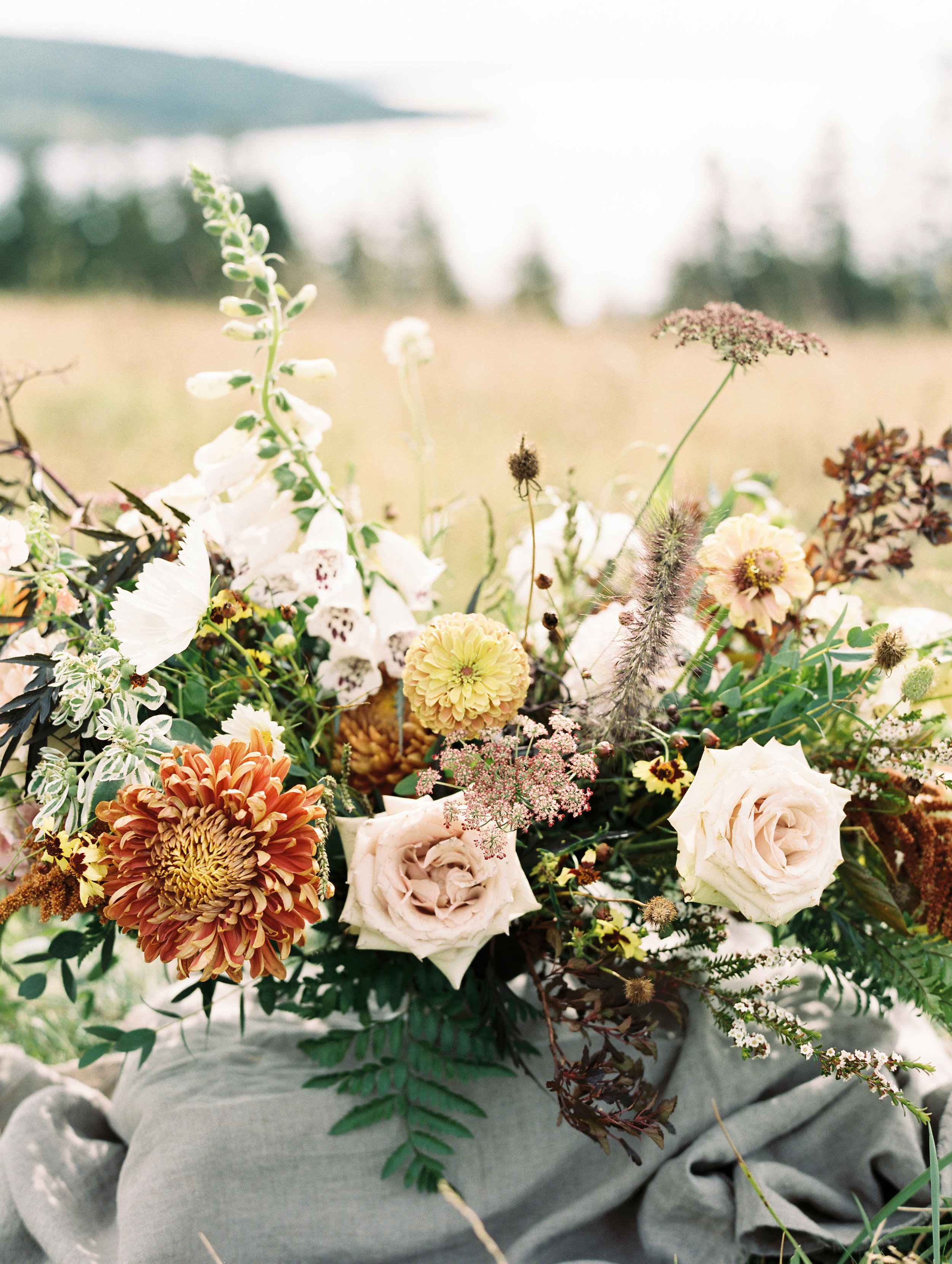 Organic, airy centerpiece of wildflowers and garden roses in muted earth tones. Nashville Wedding Florist