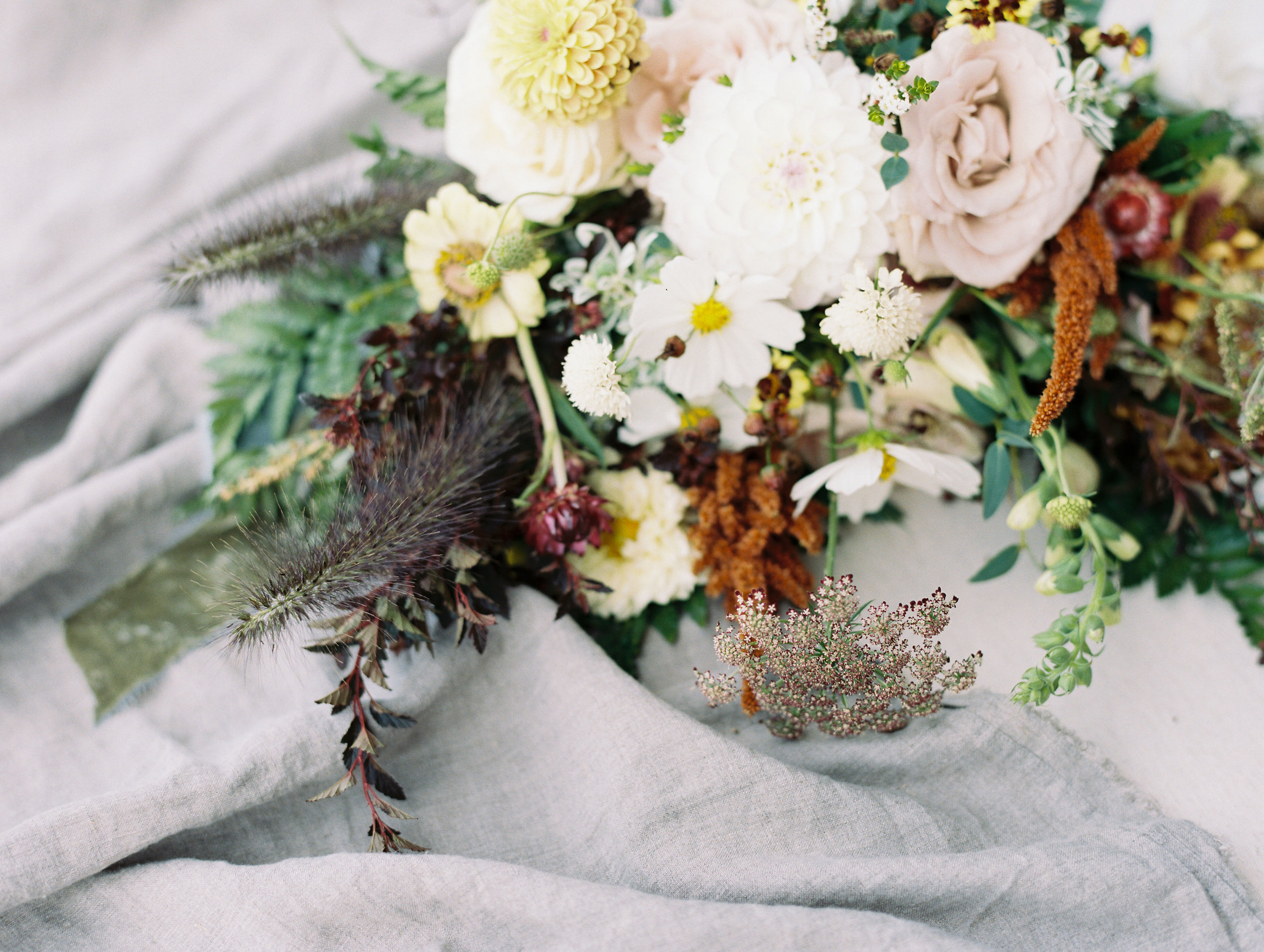 Natural, untamed bridal bouquet in neutral colors with sage green velvet ribbon. Nova Scotia Wedding Floral Design