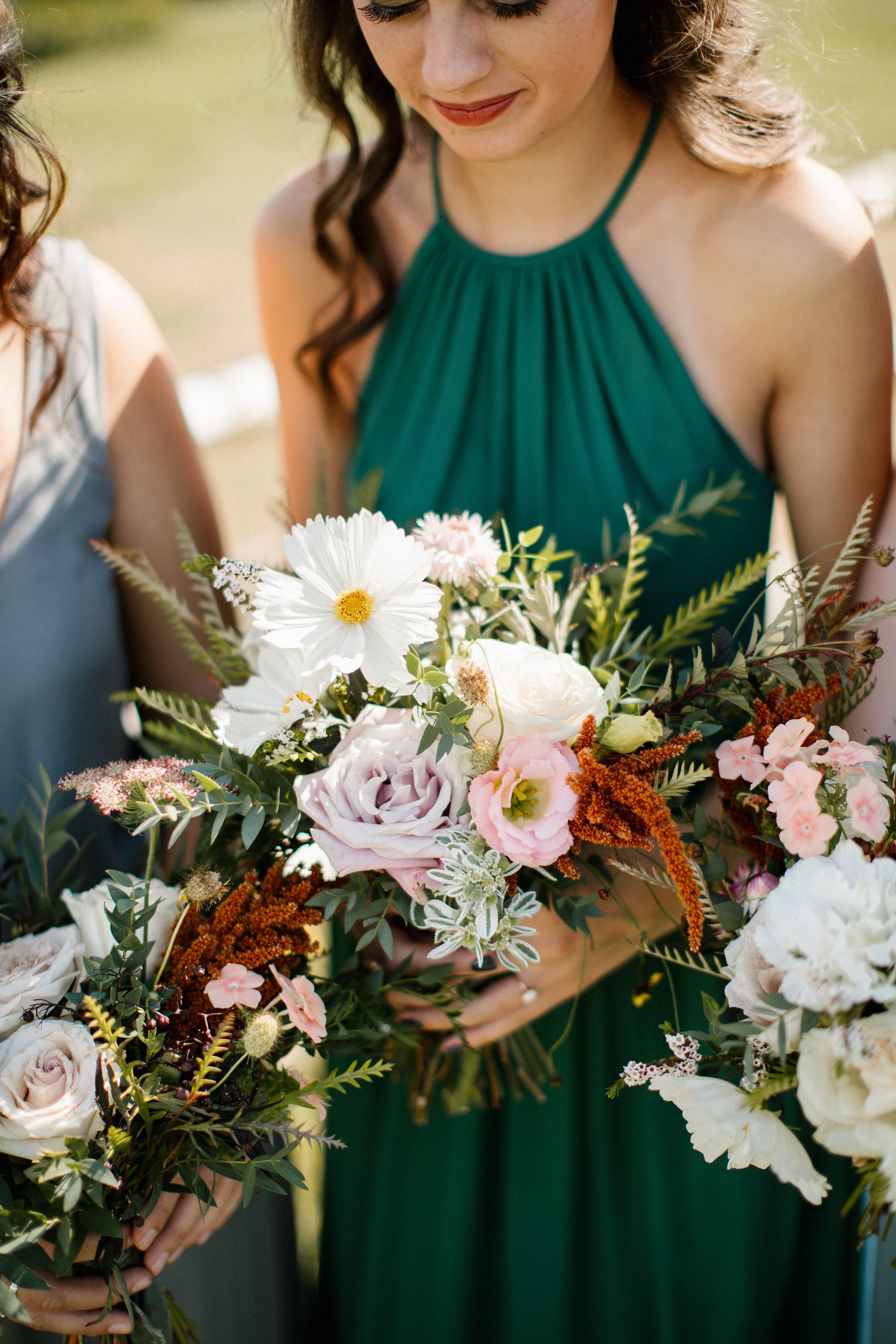 Lush bridesmaid bouquets in muted hues with wildflowers, greenery, and garden roses. Tennessee Wedding Florist
