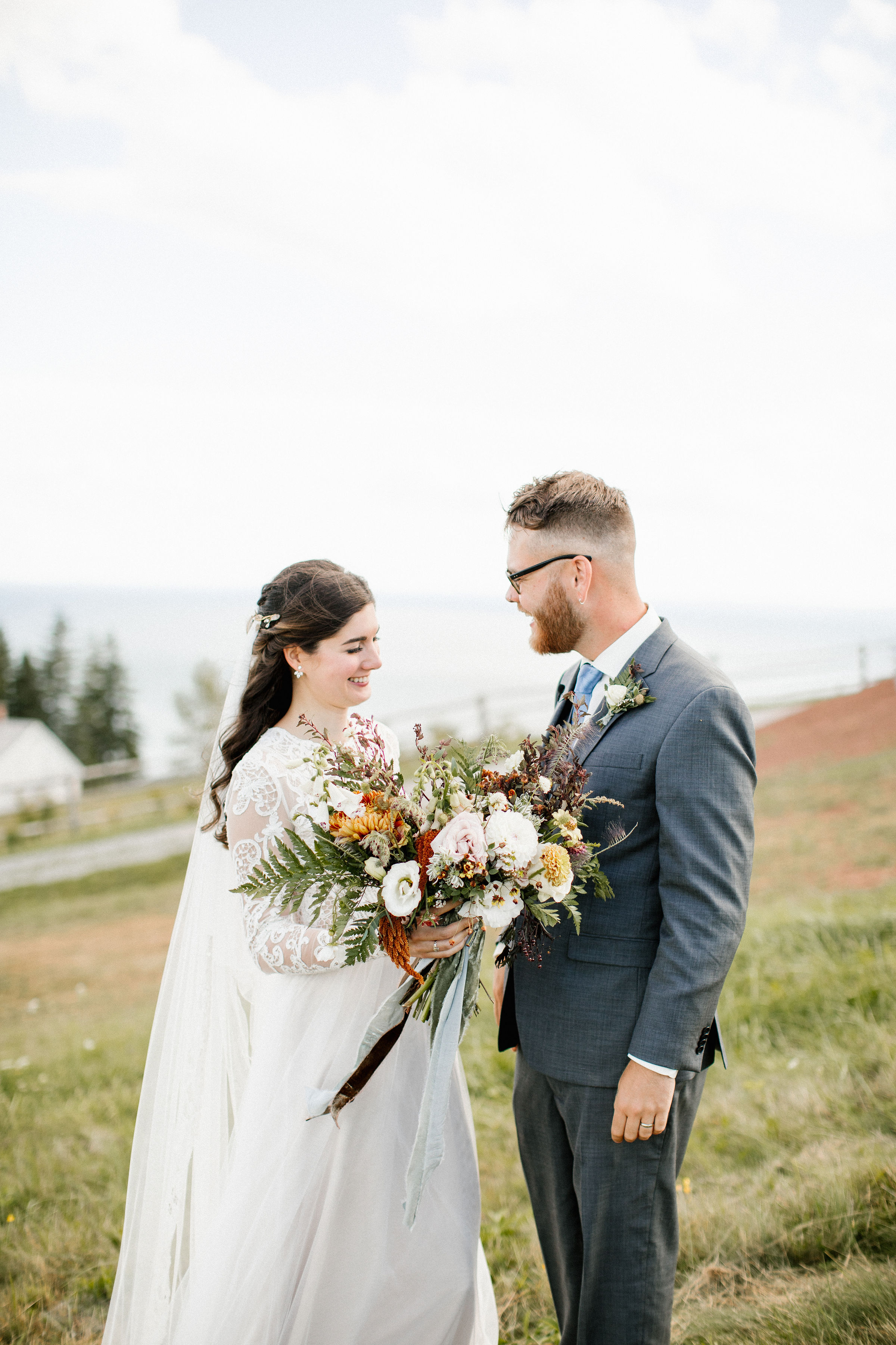 Lush bridal bouquet in muted hues with wildflowers, greenery, and garden roses. Tennessee Wedding Florist.