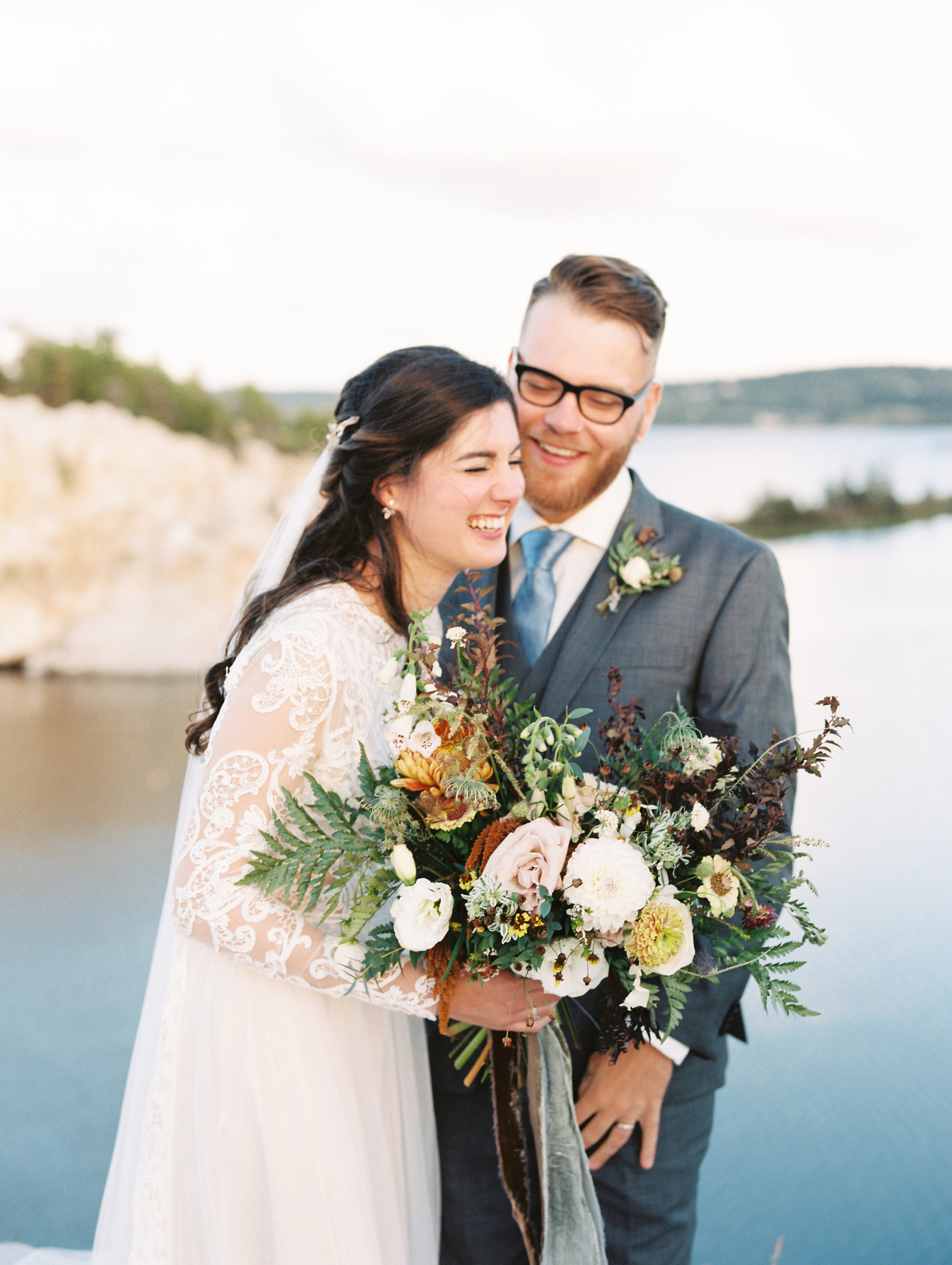 Natural, untamed bridal bouquet in neutral colors with sage green velvet ribbon. Nova Scotia Wedding Floral Design