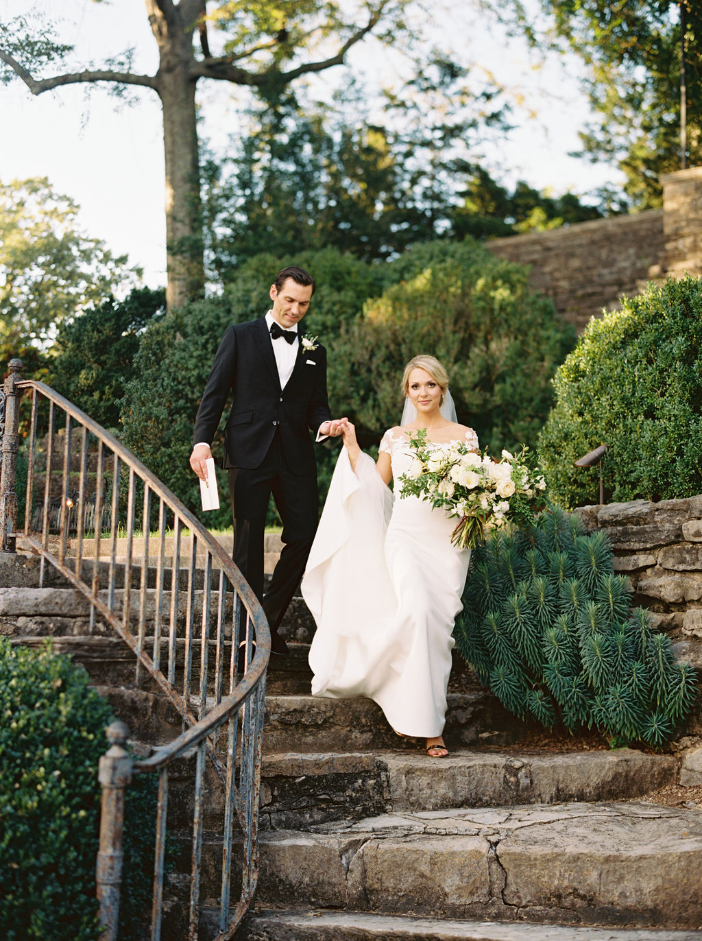 Botanic Garden Wedding with all white florals with lush greenery. Nashville Floral Designer.